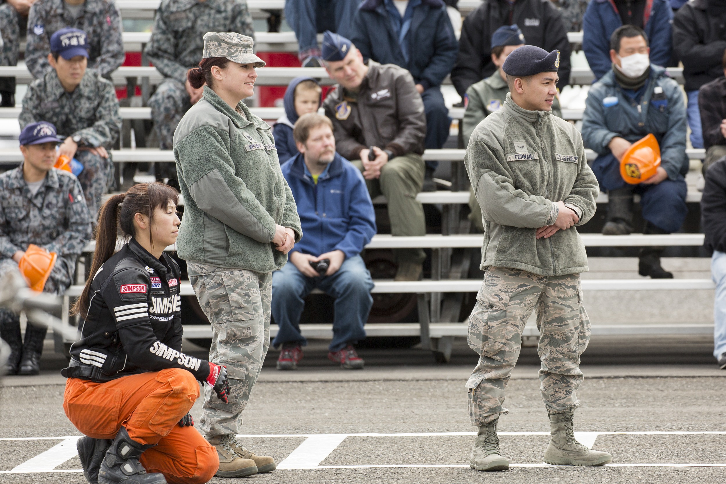 (Left to right) Tech. Sgt. Laury Napoleoni, 374th Airlift Wing Safety ground safety manager, and Airman 1st Class Lawrence Fernan, 374th Security Forces Squadron patrolman, watch an in-your-face car accident demonstration during the safety festival at Yokota Air Base, Japan, March 6, 2015. The Fussa police station sponsored a traffic safety demonstration for Yokota residents during the fest. The event demonstrated hairy moment in car accidents. (U.S. Air Force photo by Osakabe Yasuo/Released)