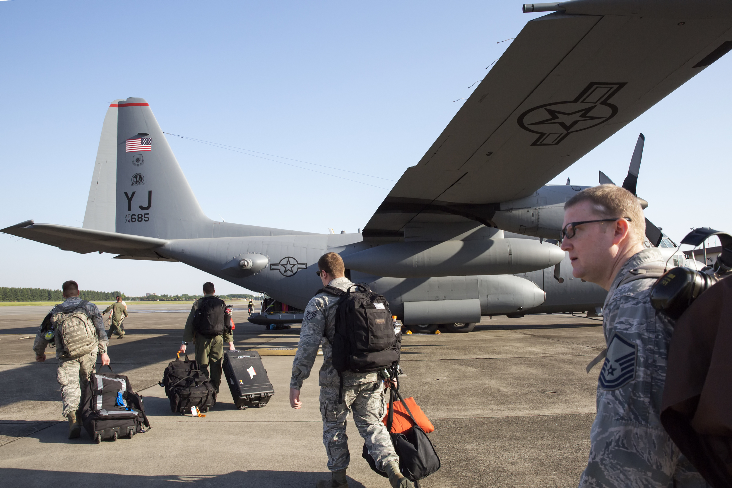 Yokota airmen board a C-130 Hercules at Yokota Air Base, Japan, May 5, 2015. Airmen departed to conduct humanitarian assistance and disaster relief operations in support of the Government of Nepal in the wake of a 7.8 magnitude earthquake that devastated many regions of the country on April 25, 2015. (U.S. Air Force photo by Osakabe Yasuo/Released)
