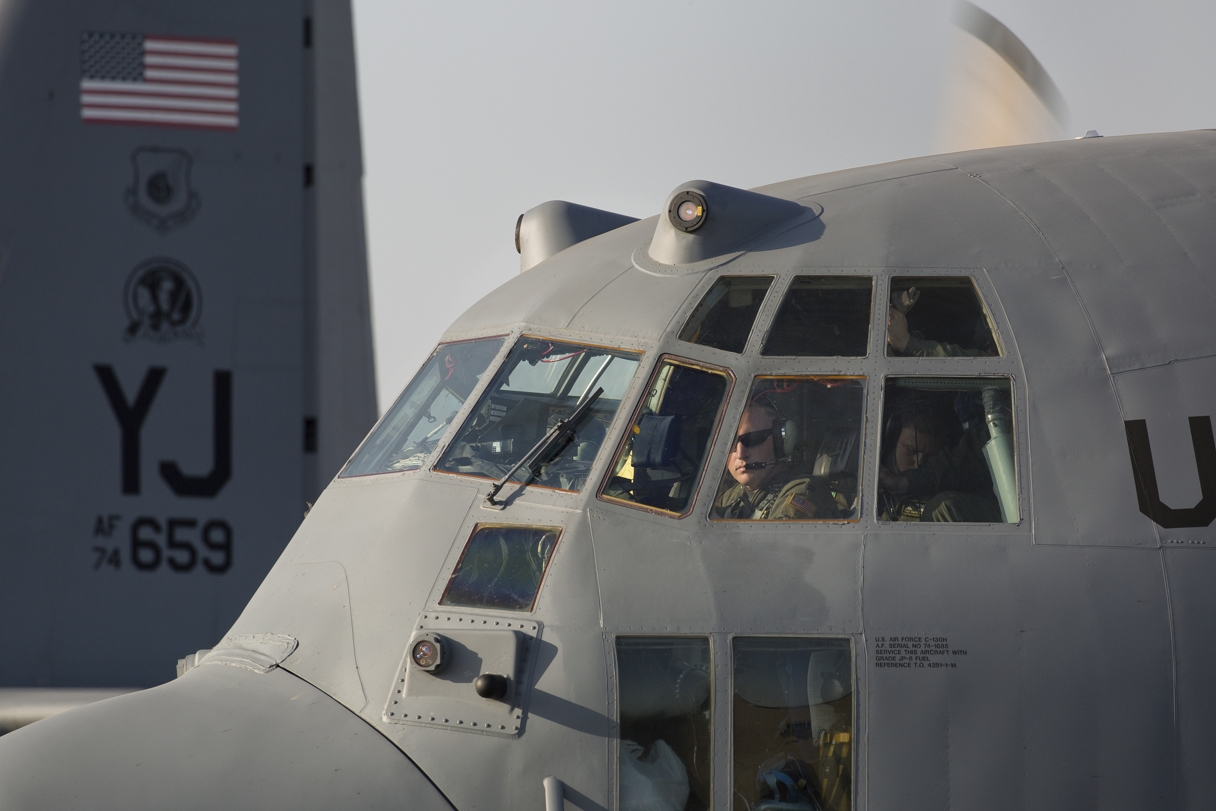 Capt. Christopher Weaver, 36th Mobility Response Squadron pilot, conducts preflight checks at Yokota Air Base, Japan, May 5, 2015. Airmen departed Yokota to support the U.S. Agency of International Development and the Government of Nepal. (U.S. Air Force photo by Osakabe Yasuo/Released)