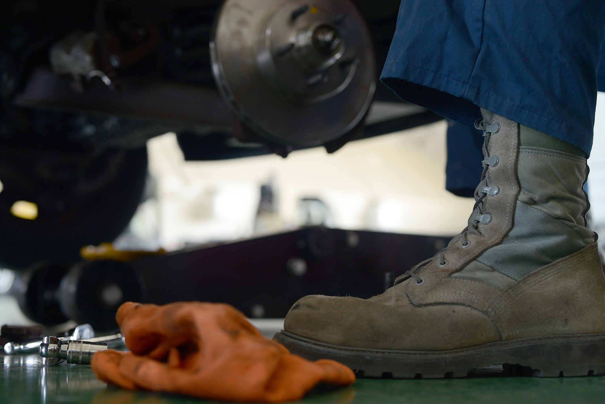 Senior Airman Brandon Higginbotham, 374th Logistics Readiness Squadron vehicle maintenance journeyman, performs maintenance on a government vehicle at Yokota Air Base, Japan, April 28, 2015. Higginbotham repairs and maintains approximately 89 vehicles per month. (U.S. Air Force photo by Airman 1st Class David C. Danford/Released)