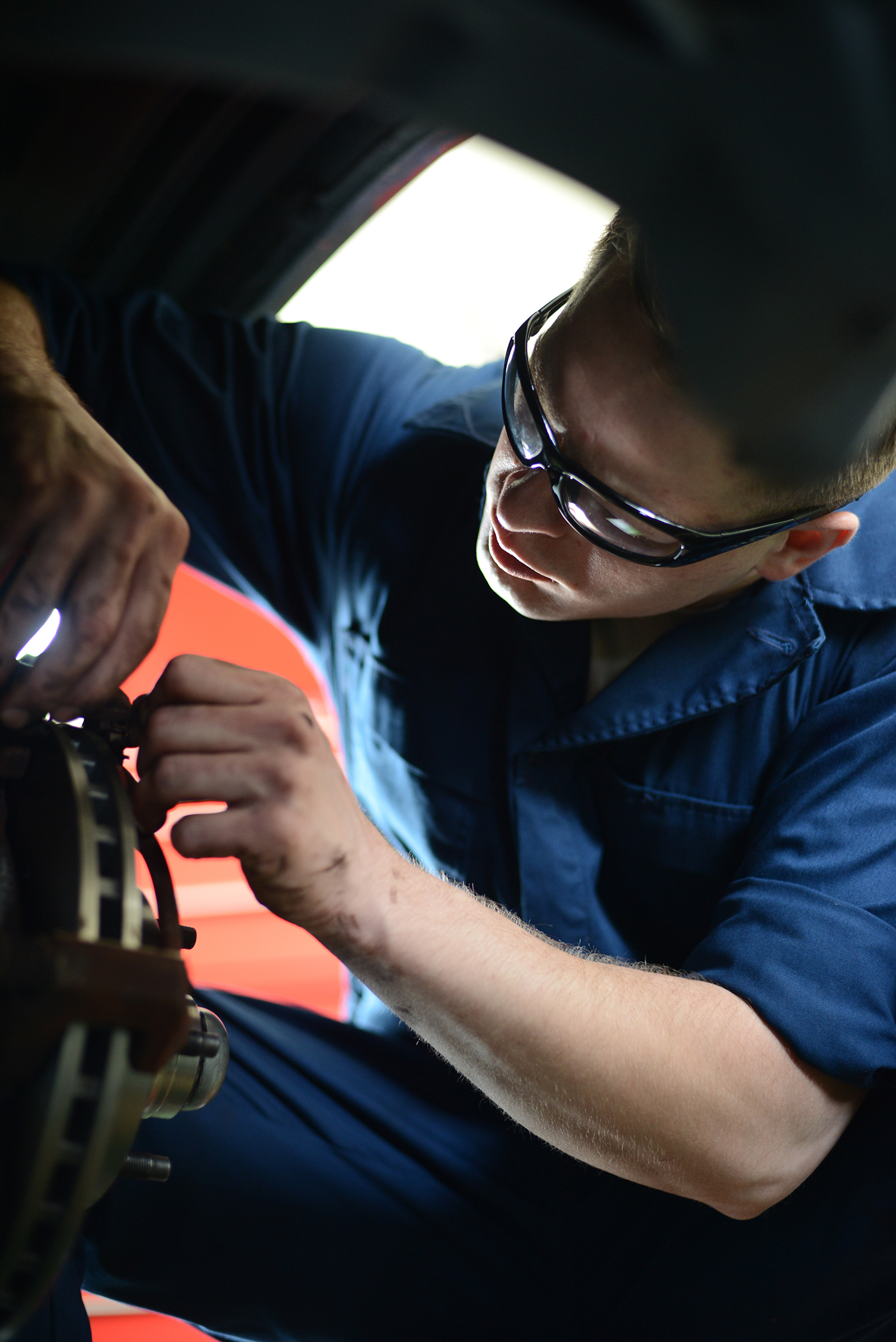 374th Logistics Readiness Squadron vehicle maintenance journeyman, Senior Airman Brandon Higginbotham, installs new brakes on a government vehicle at Yokota Air Base, Japan, April 28, 2015. Higginbotham determined that the damage to the breaks resulted from normal wear and tear. (U.S. Air Force photo by Airman 1st Class David C. Danford/Released))