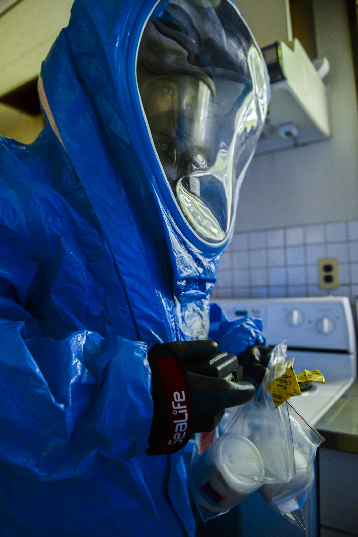 Senior Airman Vonfernan Carios, 374th Aerospace Medicine Squadron bioenvironmental engineering technician, carries samples taken from the scene of a mock environmental hazard, May 6, 2015, at Yokota Air Base, Japan. Airmen from the 374th Civil Engineering Squadron and the 374 AMDS worked together to respond during an emergency response training exercise. (U.S. Air Force photo by Airman 1st Class Elizabeth Baker/Released)
