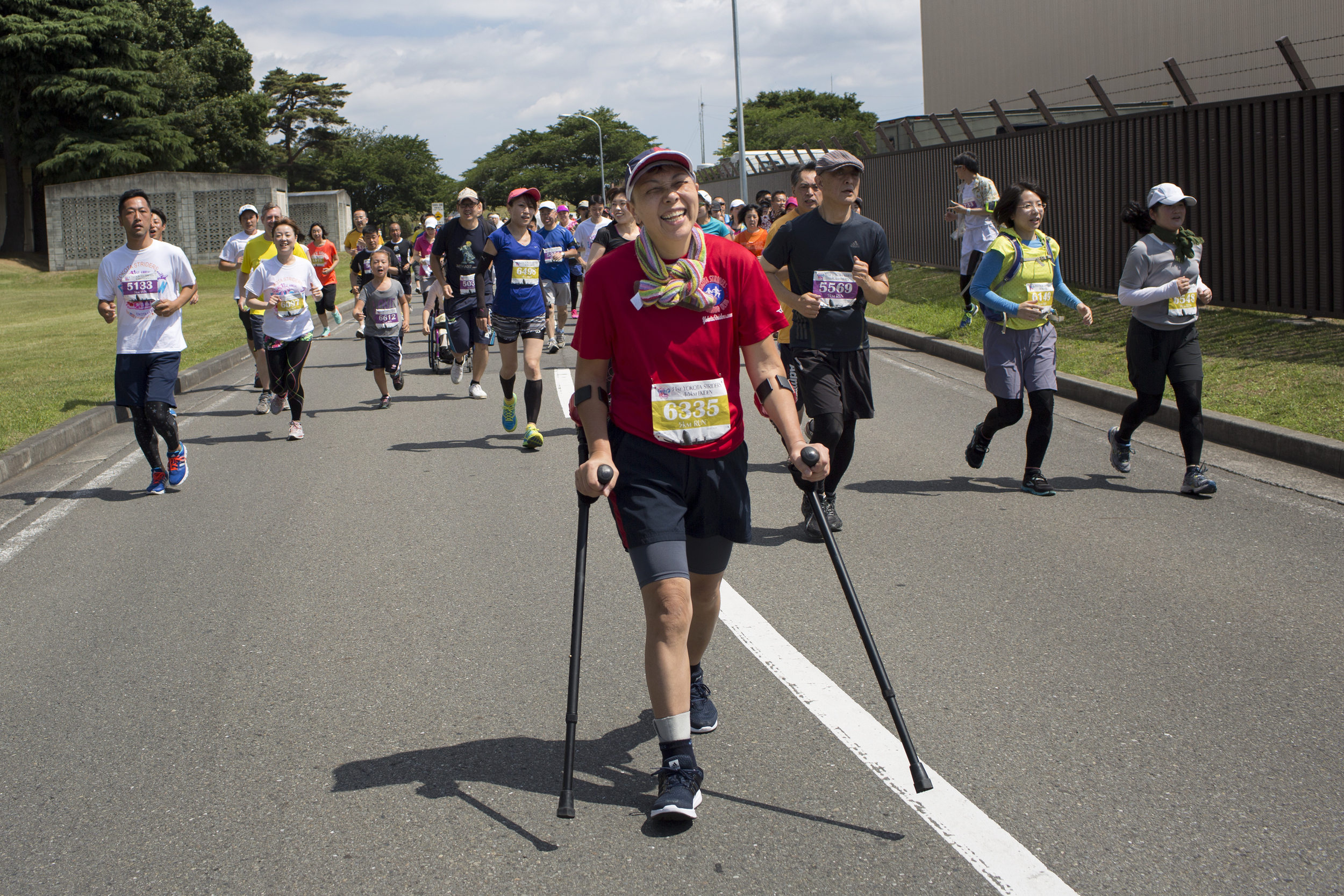 A disabled runner enjoys the 31st annual Ekiden 5K Run at Yokota Air Base, Japan, June 7, 2015. More than 5,800 runners and their families from on- and off-base participated in the event. (U.S. Air Force photo by Osakabe Yasuo/Released)