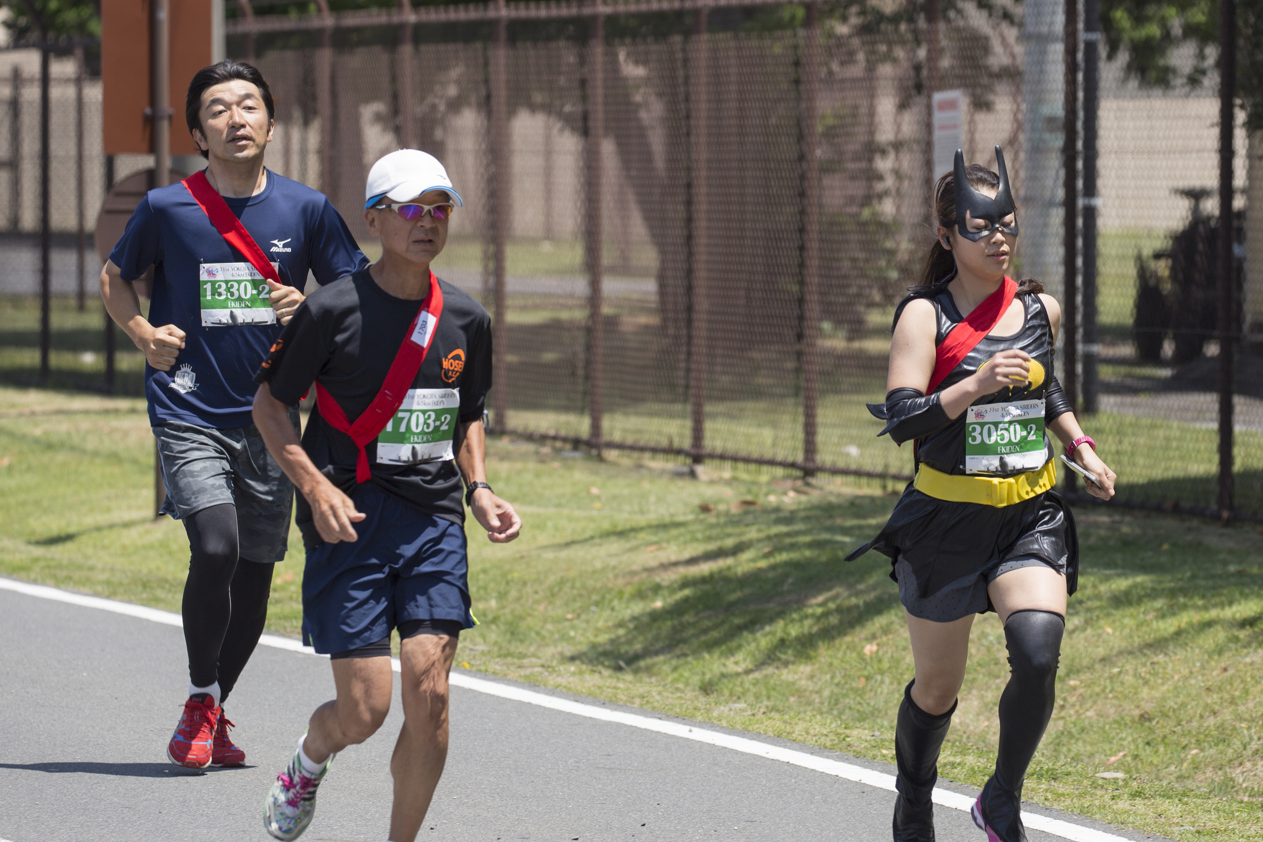 Runners participate in the 31st annual Ekiden Run at Yokota Air Base, Japan, June 7, 2015. The Yokota Striders running club sponsored the annual Ekiden Run consisting of three different races at this event: a 4-person 5k relay, 5k race, and 2k Kid's Run. (U.S. Air Force photo by Osakabe Yasuo/Released)