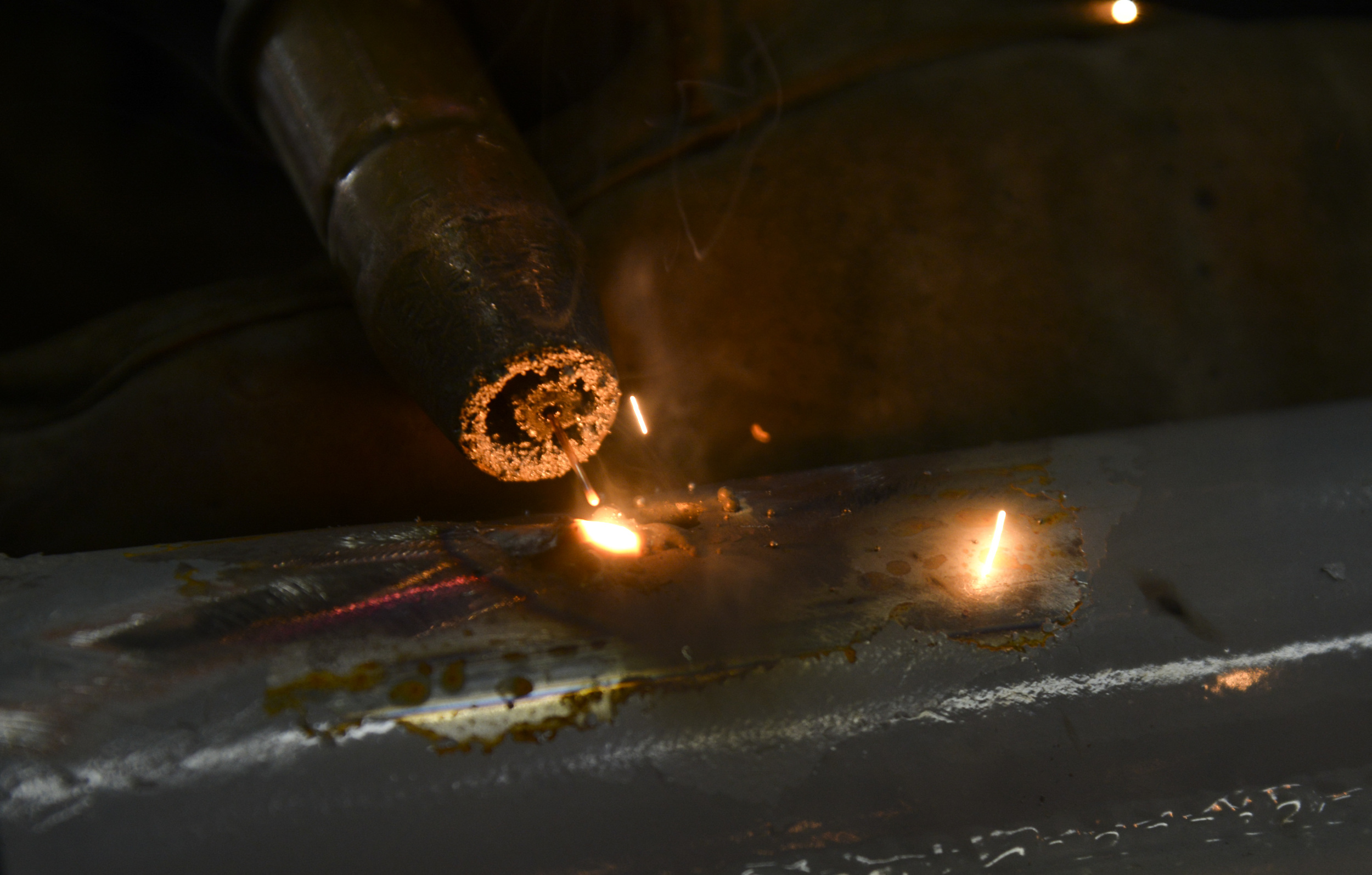 Airman 1st Class Curtis Doherty, 374th Maintenance Squadron aircraft metals technology journeyman, welds a post hole for a B-1 platform in the fabrication shop at Yokota Air Base, Japan, June 23, 2015. The metal technology shop works on 20 to 80 pieces of equipment each week. (U.S. Air Force photo by Senior Airman David Owsianka/Released)