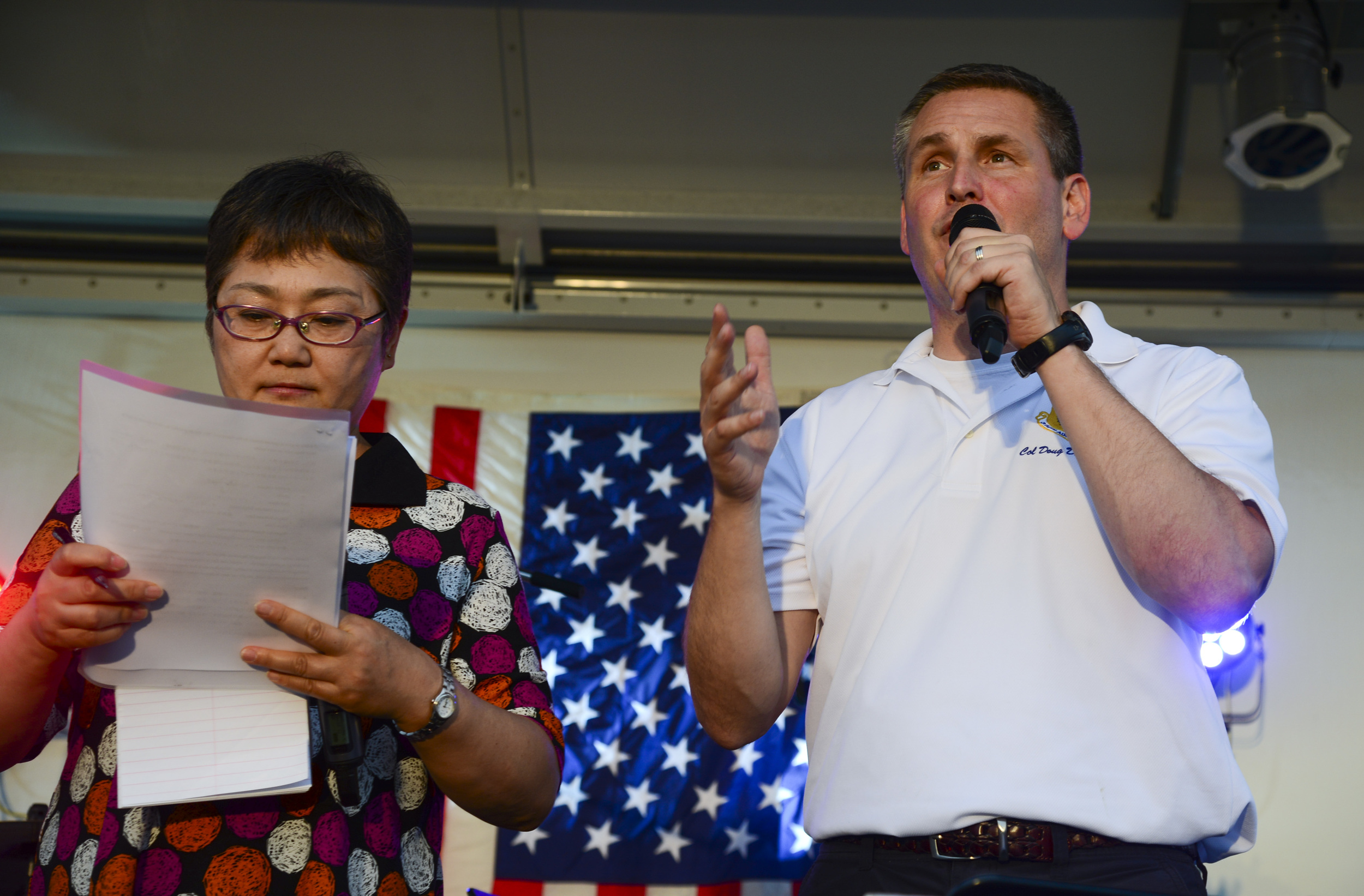Col. Douglas DeLaMater, 374th Airlift Wing commander, gives a speech during the Celebrate America event at Yokota Air Base, Japan, July 2, 2015. Festivities of the day included a 5K run, live music performances, petting zoos, go-kart racing and fireworks in celebration of Independence Day. (U.S. Air Force photo by Senior Airman David Owsianka/Released)