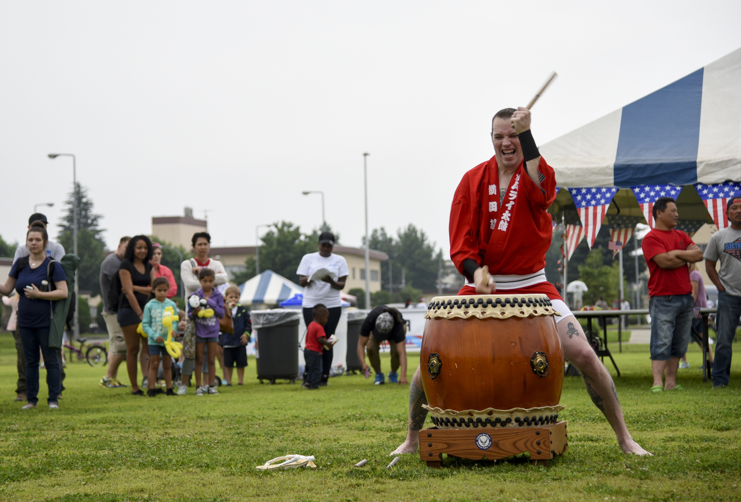 Master Sgt. Casey Hagen, 374th Maintenance Squadron, participates in a Taiko drum performance during Celebrate America at Yokota Air Base, Japan, July 2, 2015. The annual event provided military members and their families the opportunity to enjoy games, food and bands before culminating in a fireworks display to celebrate Independence Day. (U.S. Air Force photo by Senior Airman Michael Washburn/Released)