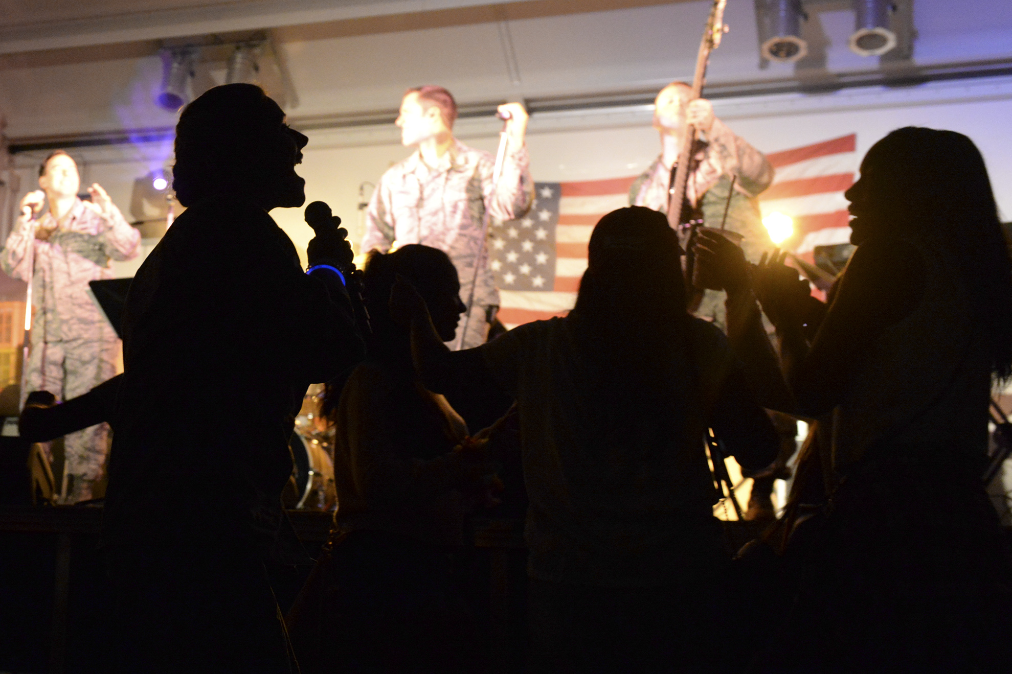 A Band of the Pacific-Hawaii performer sings for the audience at Yokota Air Base, Japan, July 2, 2015. The band performed popular songs with themes celebrating America and in honor of Independence Day. (U.S. Air Force photo by Airman 1st Class Elizabeth Baker/Released)