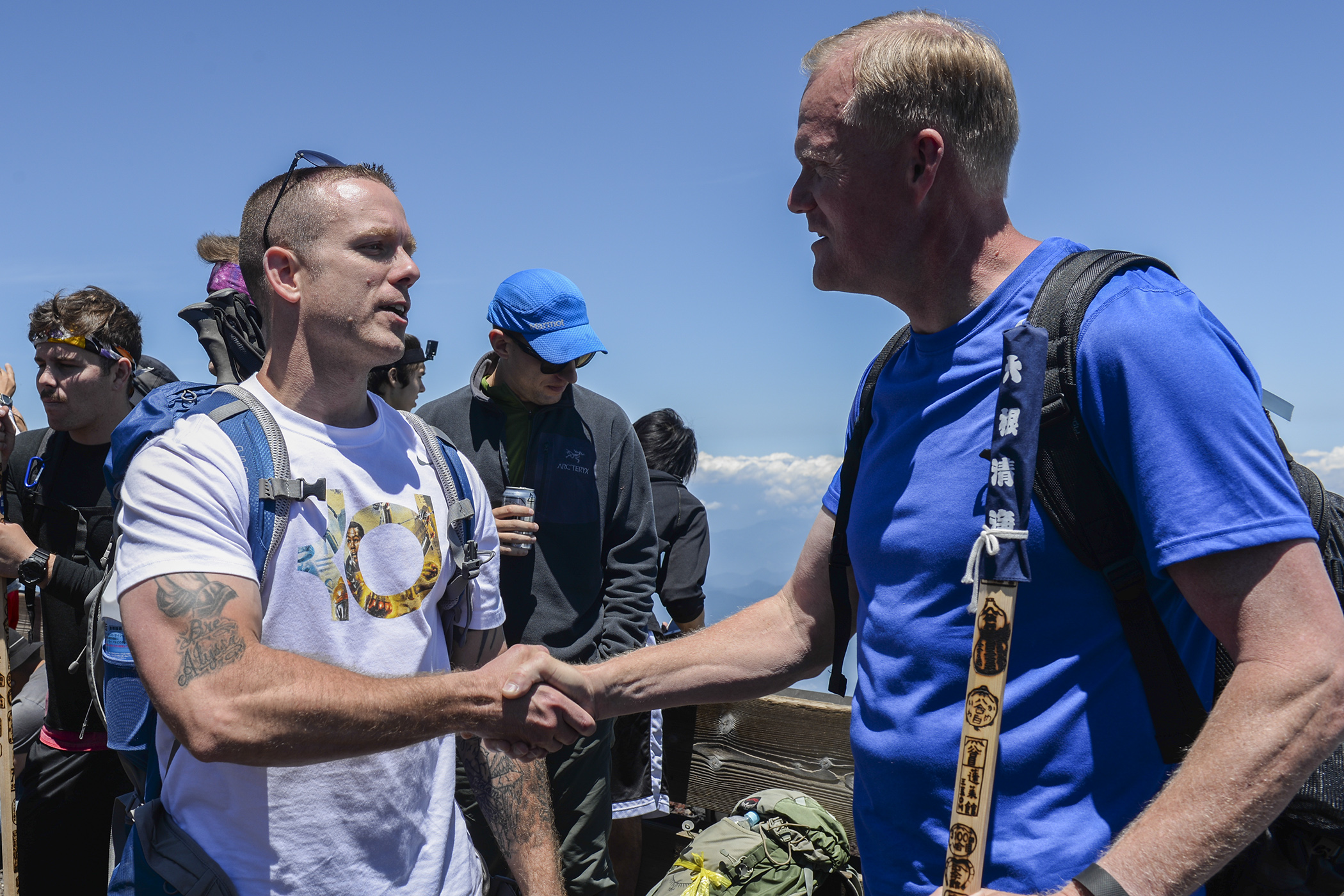 An Airman thanks Chief Master Sergeant of the Air Force, James A. Cody, for hiking alongside members of team Yokota at Mount Fuji, Japan, July 11, 2015. Cody invited Yokota personnel to join him on the hike so that he could take time to interact with them. (U.S. Air Force photo by Airman 1st Class Elizabeth Baker/Released)