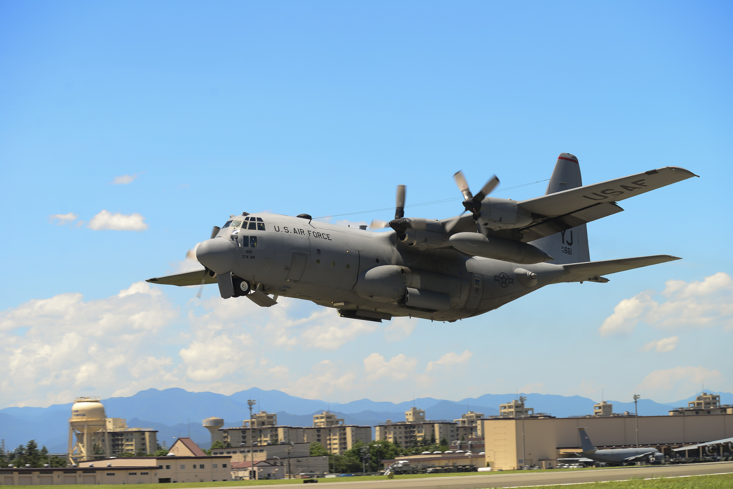 A C-130 Hercules takes off during a training exercise at Yokota Air Base, Japan, July 14, 2015. Ten C-130s participated in the exercise which tested the 36th Airlift Squadron's ability to perform large formation flights. (U.S. Air Force photo by Senior Airman David Owsianka/Released)
