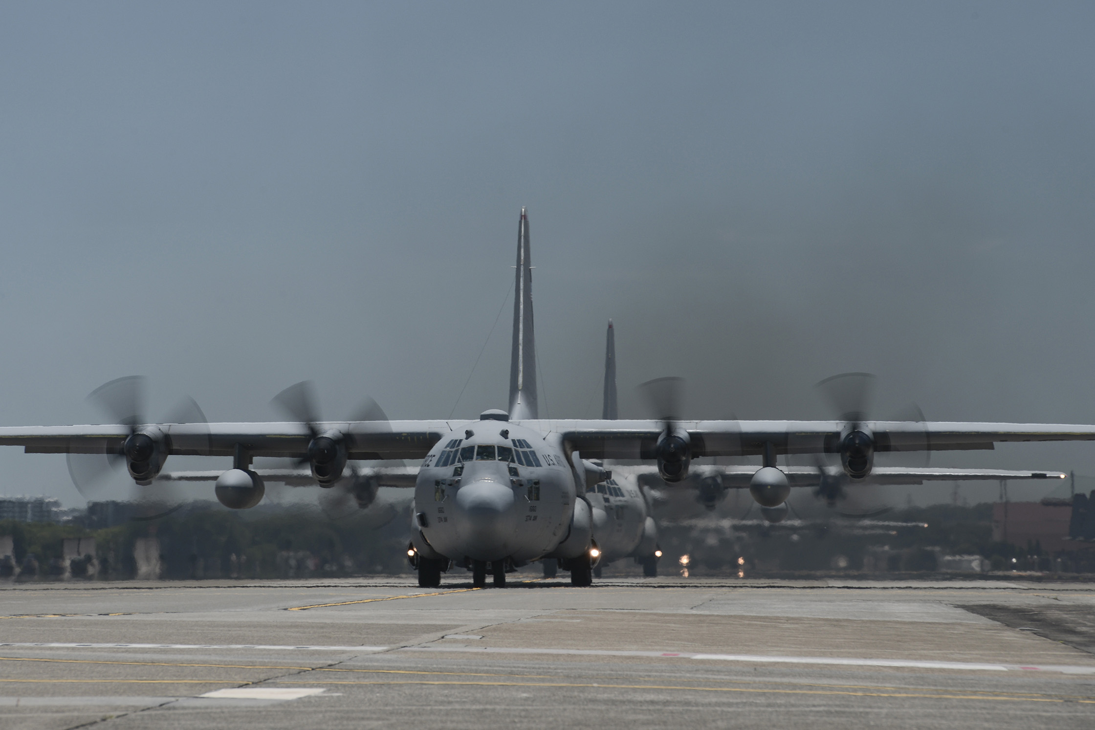 Multiple C-130 Hercules taxi during large formation training at Yokota Air Base, Japan, July 14, 2015. Nine C-130s took off during the training, practicing their large formation and airlift capabilities. (U.S. Air Force photo by Staff Sgt. Cody H. Ramirez/ Released)