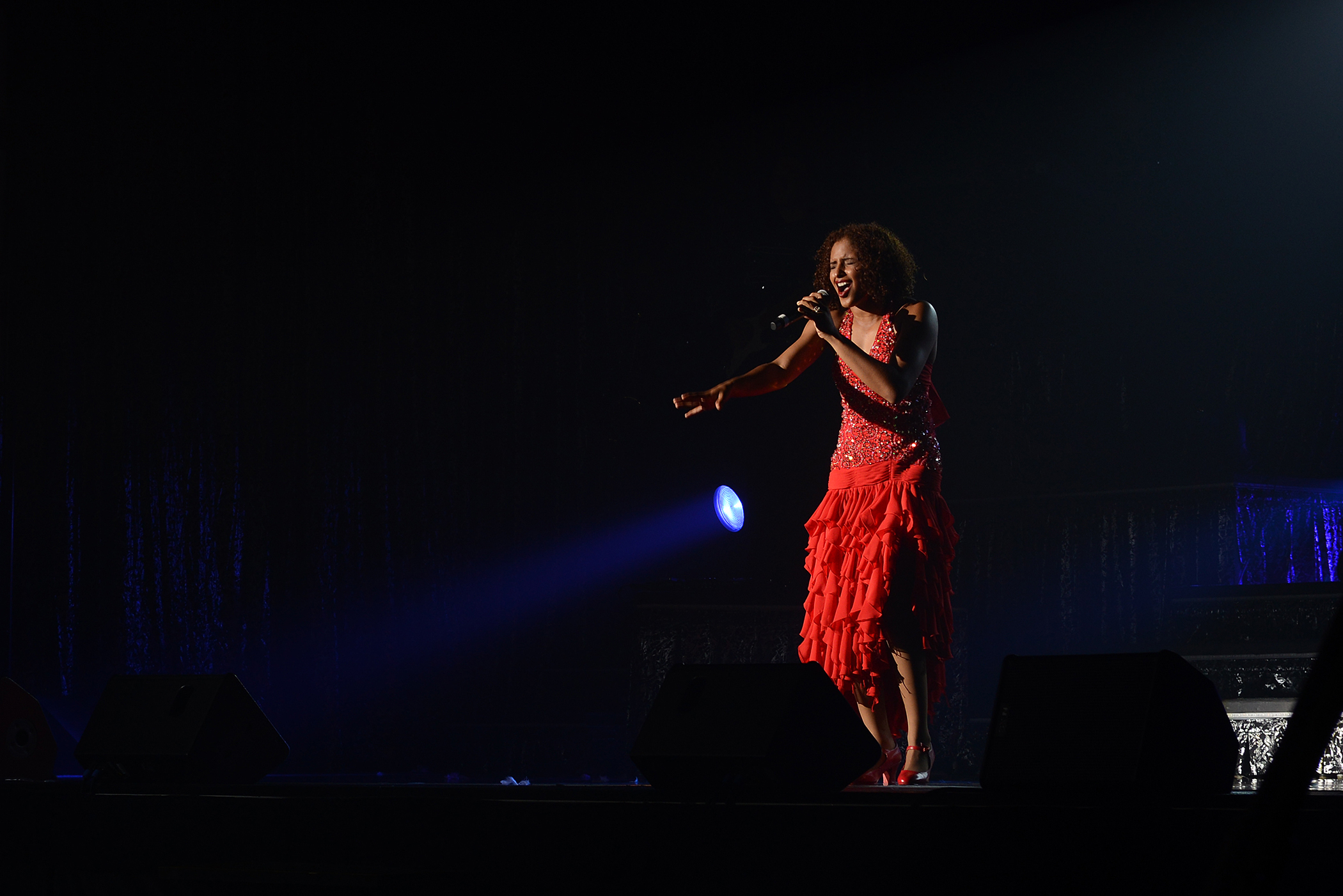 """A vocalist with Tops in Blue performs Donna Summer's """"Last Dance"""" at Yokota Air Base, Japan, July 19, 2015. The show's theme was America's musical history through the 20th century. (U.S. Air Force photo by Airman 1st Class David C. Danford/Released)"""