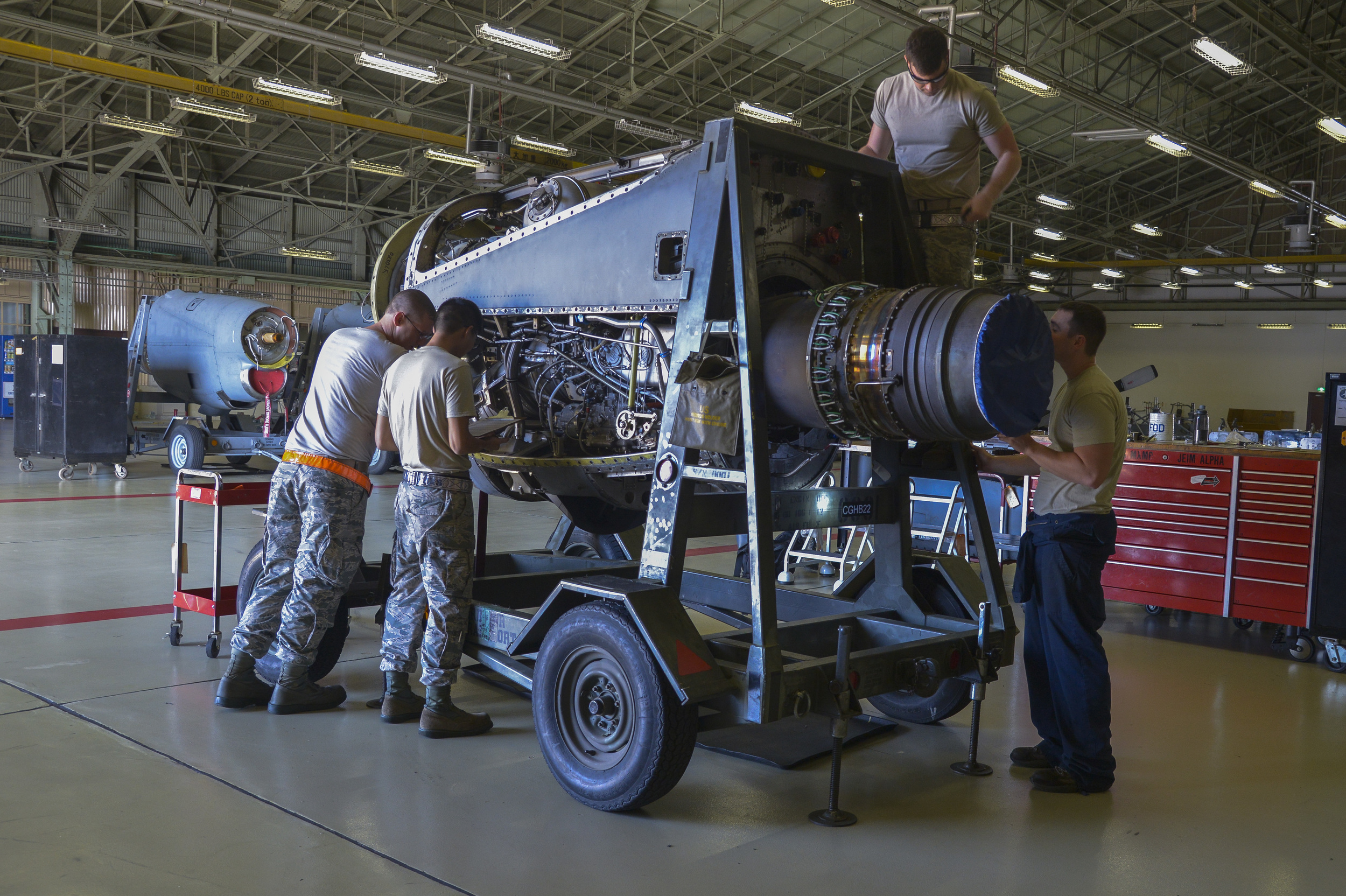Airmen with the 374th Maintenance Squadron propulsion flight inspect an engine prior to going through an operational check in the test cell at Yokota Air Base, Japan, Sept. 23, 2015. The jet engine intermediate maintenance section performs routine maintenance work on the engines and rebuilds them when necessary. (U.S. Air Force photo by Senior Airman David Owsianka/Released)