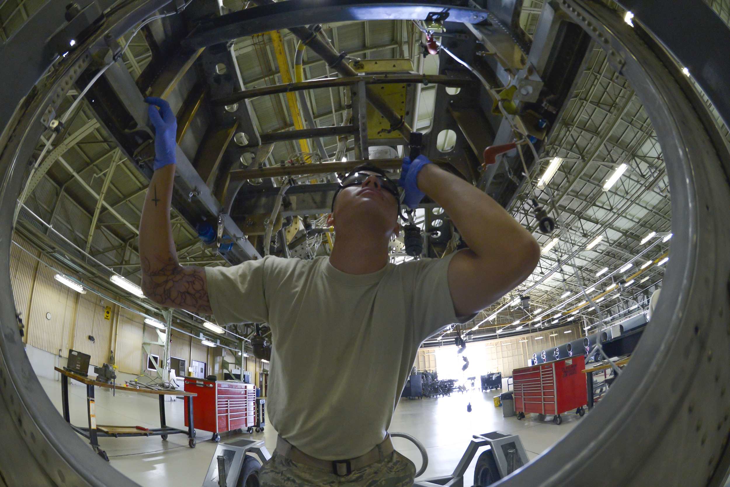 Airman 1st Class Gage Walker, 374th Maintenance Squadron propulsion flight aerospace propulsion apprentice, inspects a lower mount beam on a quick engine change kit at Yokota Air Base, Japan, Sept. 23, 2015. The kit section plays an important role within the flight during a compressor module change because the engine is removed and the Airmen are able to reach tough areas of the engine. (U.S. Air Force photo by Senior Airman David Owsianka/Released)