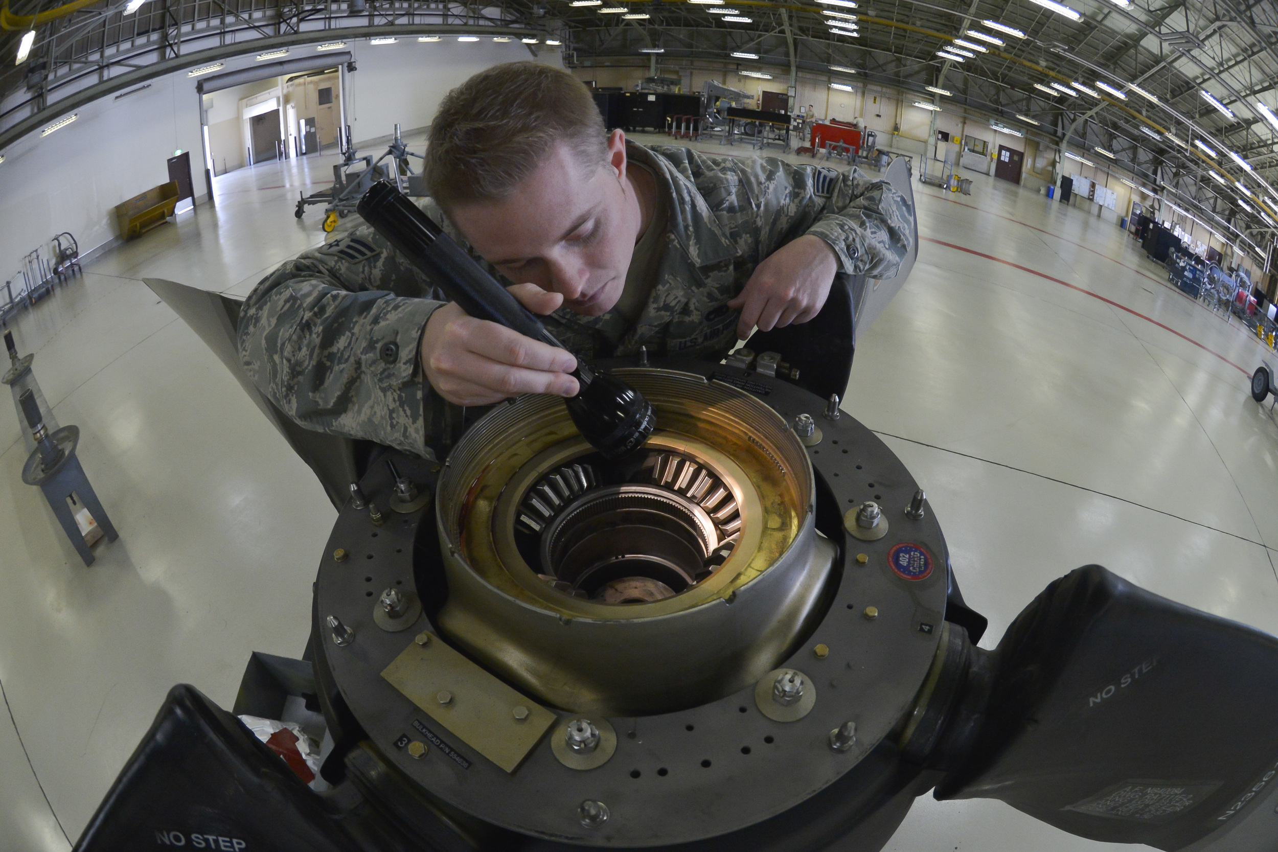 Senior Airman Colton Windsor, 374th Maintenance Squadron propulsion flight aerospace propulsion journeyman, inspects the blade teeth of the propeller at Yokota Air Base, Japan, Sept. 23, 2015. In addition to providing support for both Yokota and Kadena Air Base, the flight provides engine and propeller support for all active duty, guard and reserve C-130s tasked within their area of responsibility. (U.S. Air Force photo by Senior Airman David Owsianka/Released)