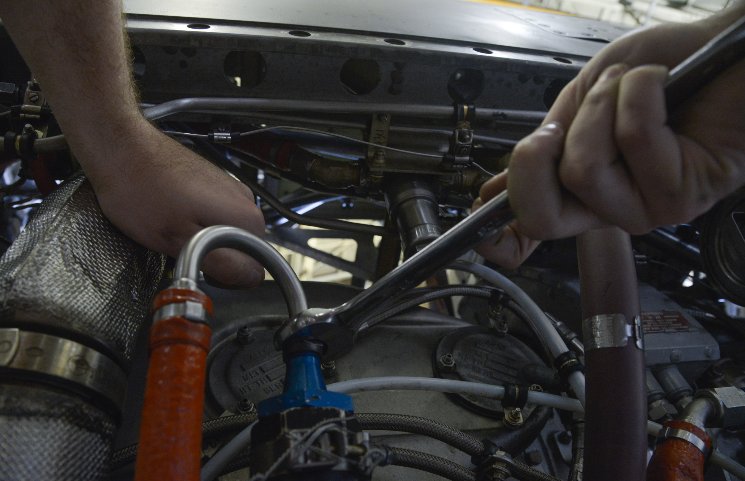 Airman Sam Johnson, 374th Maintenance Squadron propulsion flight aerospace propulsion apprentice, tightens a bolt on a low-pressure fuel filter on an engine at Yokota Air Base, Japan, Sept. 23, 2015. In addition to providing support for both Yokota and Kadena Air Base, the flight provides engine and propeller support for all active duty, guard and reserve C-130s tasked within their area of responsibility. (U.S. Air Force photo by Senior Airman David Owsianka/Released)