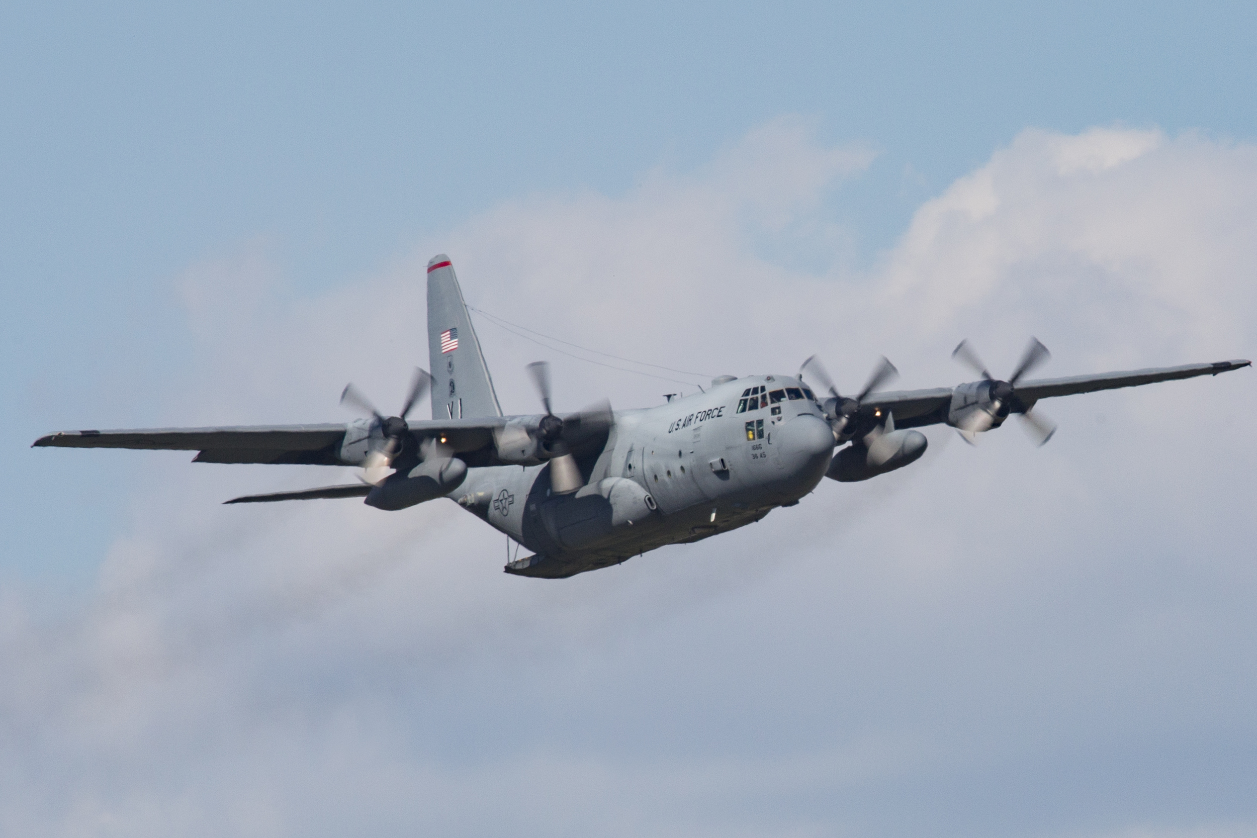 A C-130 Hercules from the 36th Airlift Squadron is ready to perform a low-cost, low-altitude airdrop at Yokota Air Base, Japan, Oct. 8, 2015. The LCLA airdrops are a special container delivery system, designed to be used and discarded rather than turned in and reused. (U.S. Air Force photo by Osakabe Yasuo/Released)