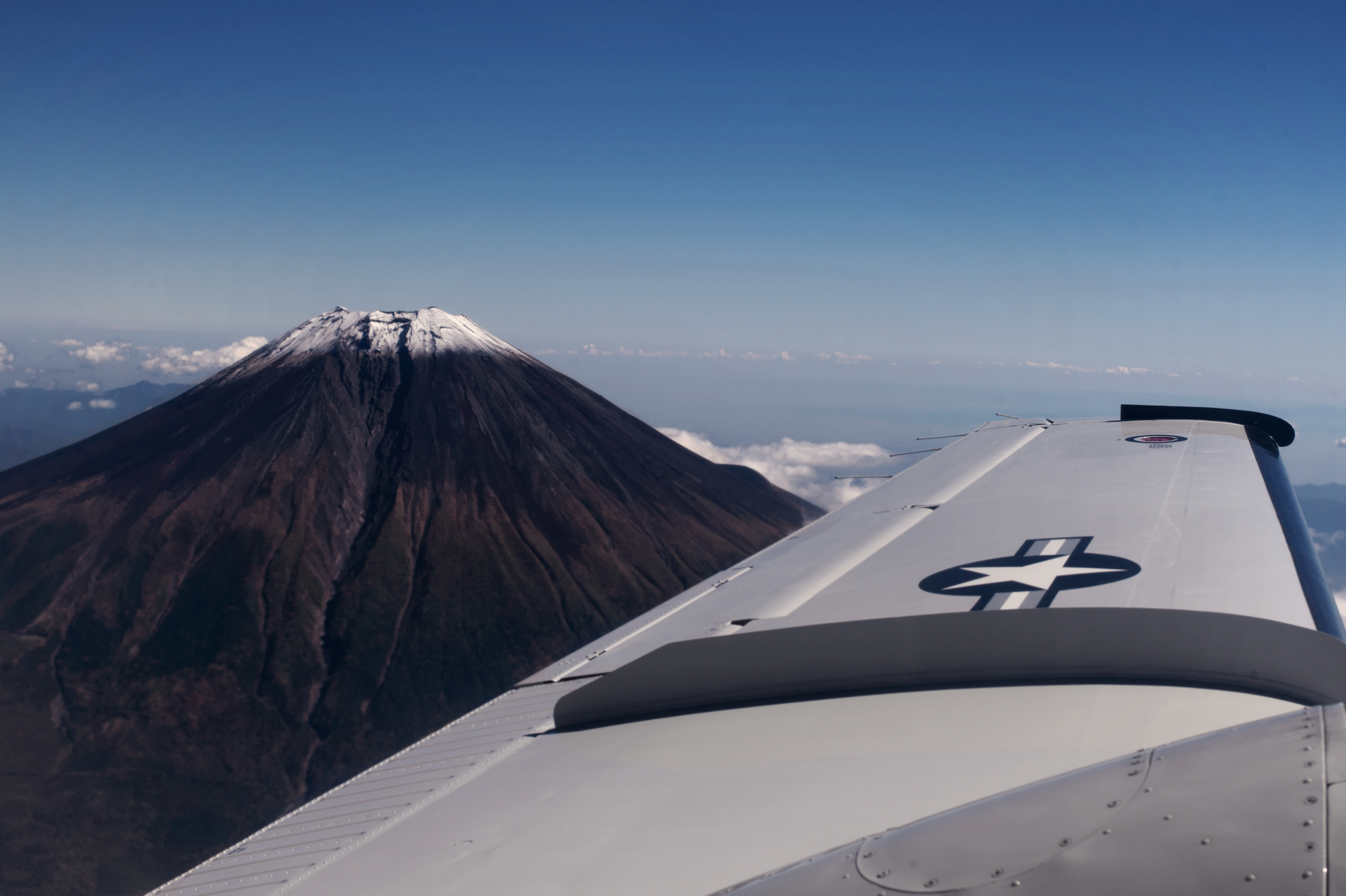 A C-12 Huron assigned to the 459th Airlift Squadron flies near Mt. Fuji, Japan, during a training mission, Oct. 13, 2015. The 459th utilizes the C-12H to maintain a forward presence in the Indo-Asia Pacific region and to provide support for distinguished visitors, as well as other priority passengers and cargo, on travel vital to the national security interest of the United States. (U.S. Air Force photo by Airman 1st Class Delano Scott/Released)
