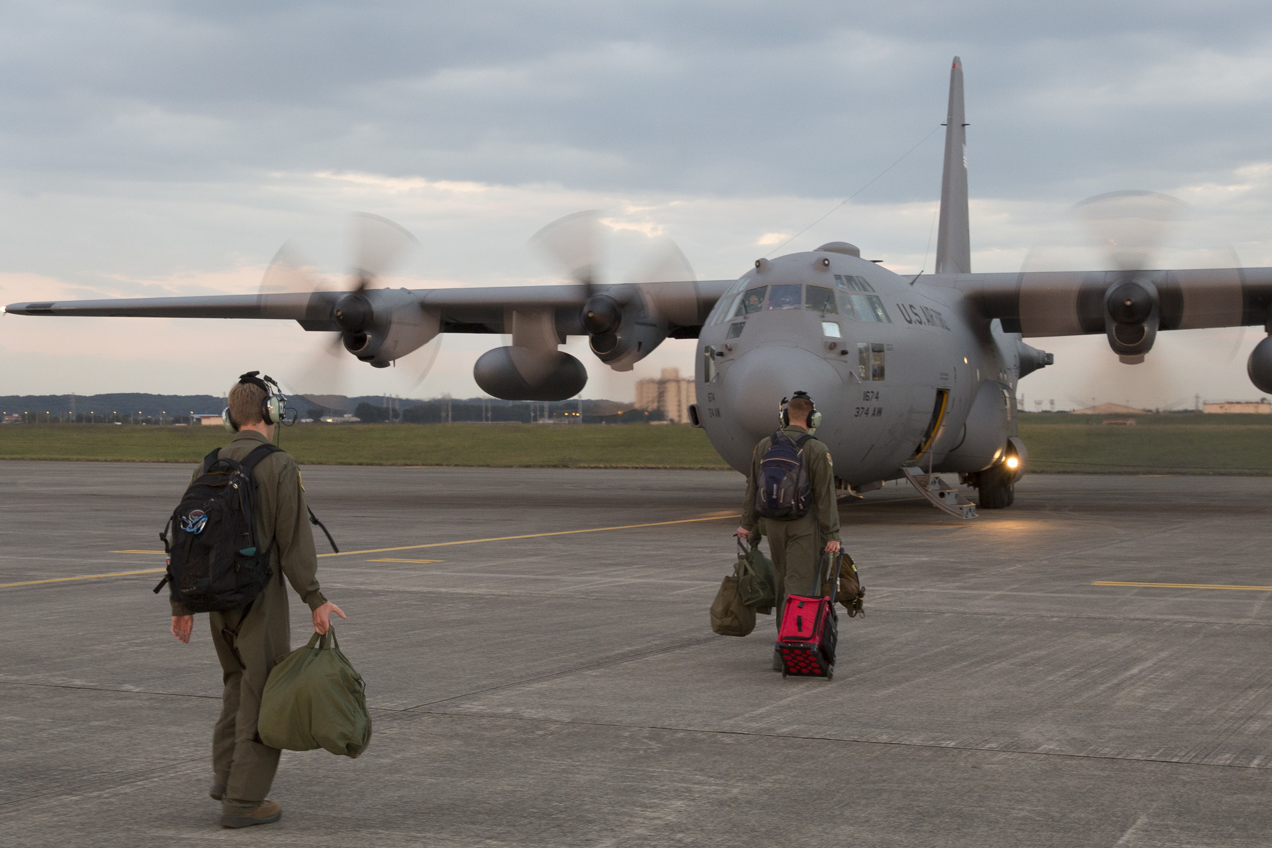 Aircrews walk to a C-130 Hercules at Yokota Air Base, Japan, Oct. 14, 2015, during a training mission. The training mission ensured that the airlifters are ready to respond to a variety of contingencies throughout the Indo-Asia Pacific region. (U.S. Air Force photo by Osakabe Yasuo/Released)
