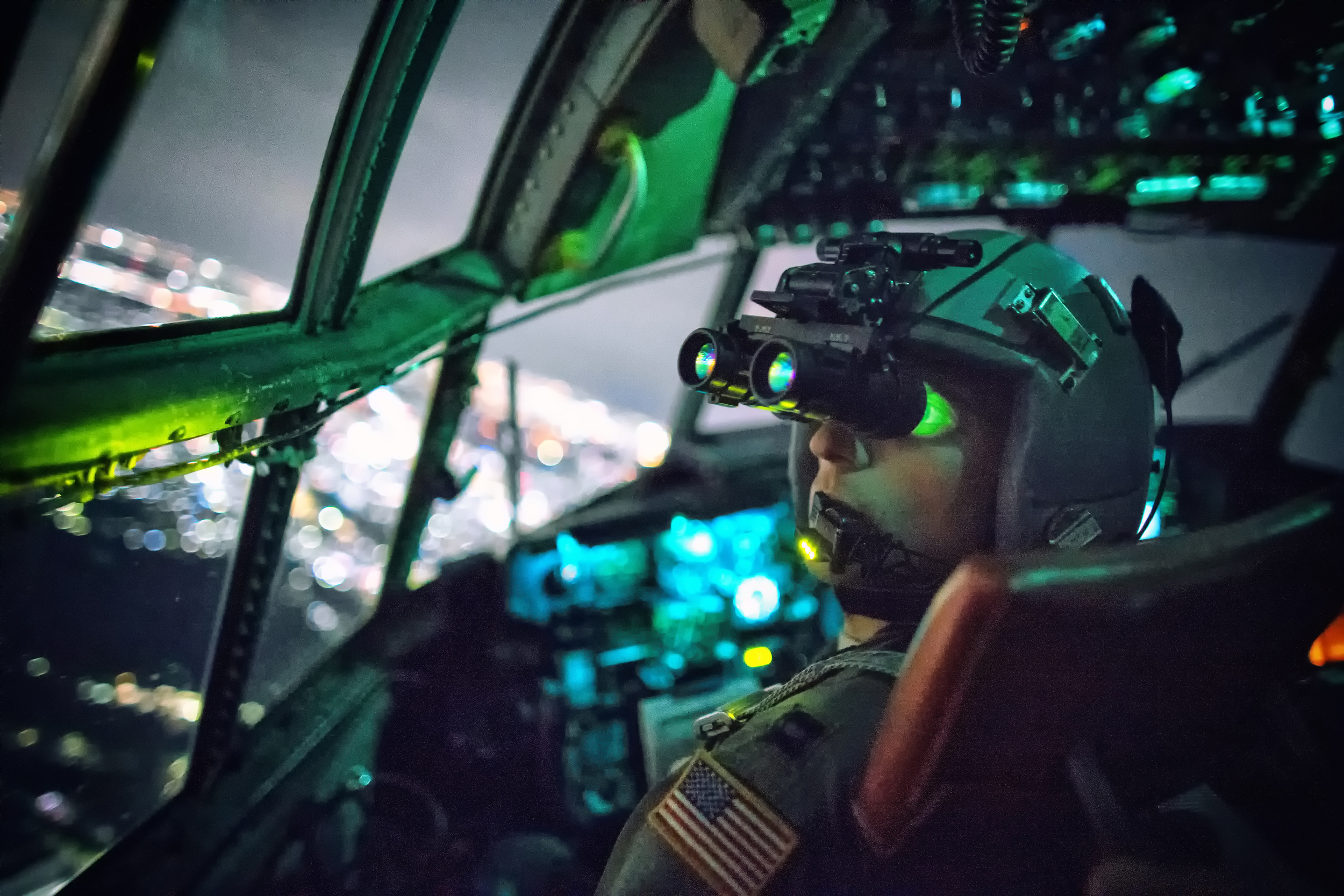 Capt. Thomas Bernard, 36th Airlift Squadron C-130 Hercules pilot, performs a visual confirmation with a night vision goggle during a training mission over Kanto Plane, Japan, Oct. 14, 2015. Yokota aircrews regularly conduct night flying operations to ensure they're prepared to respond to a variety of contingencies throughout the Indo-Asia Pacific region. (U.S. Air Force photo by Osakabe Yasuo/Released)