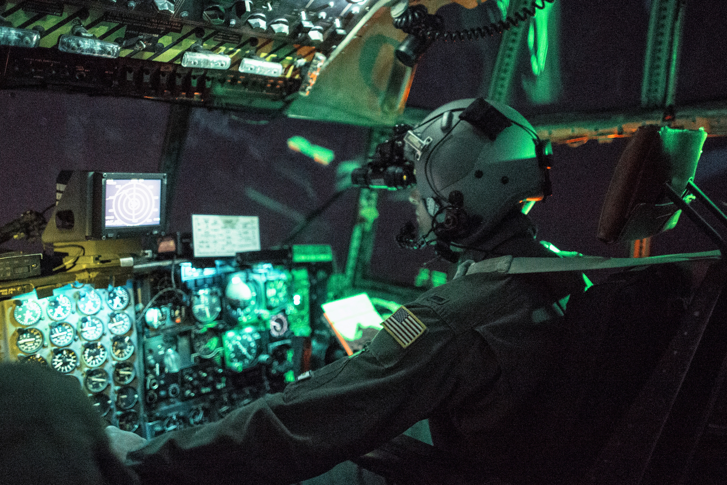 1st Lt. Randall Kanzelmeyer, 36th Airlift Squadron c-130 Hercules pilot, wears a night vision goggle during a training mission above Yokota Air Base, Japan, Oct. 14, 2015. Yokota aircrews regularly conduct night flying operations to ensure they're prepared to respond to a variety of contingencies throughout the Indo-Asia Pacific region. (U.S. Air Force photo by Osakabe Yasuo/Released)