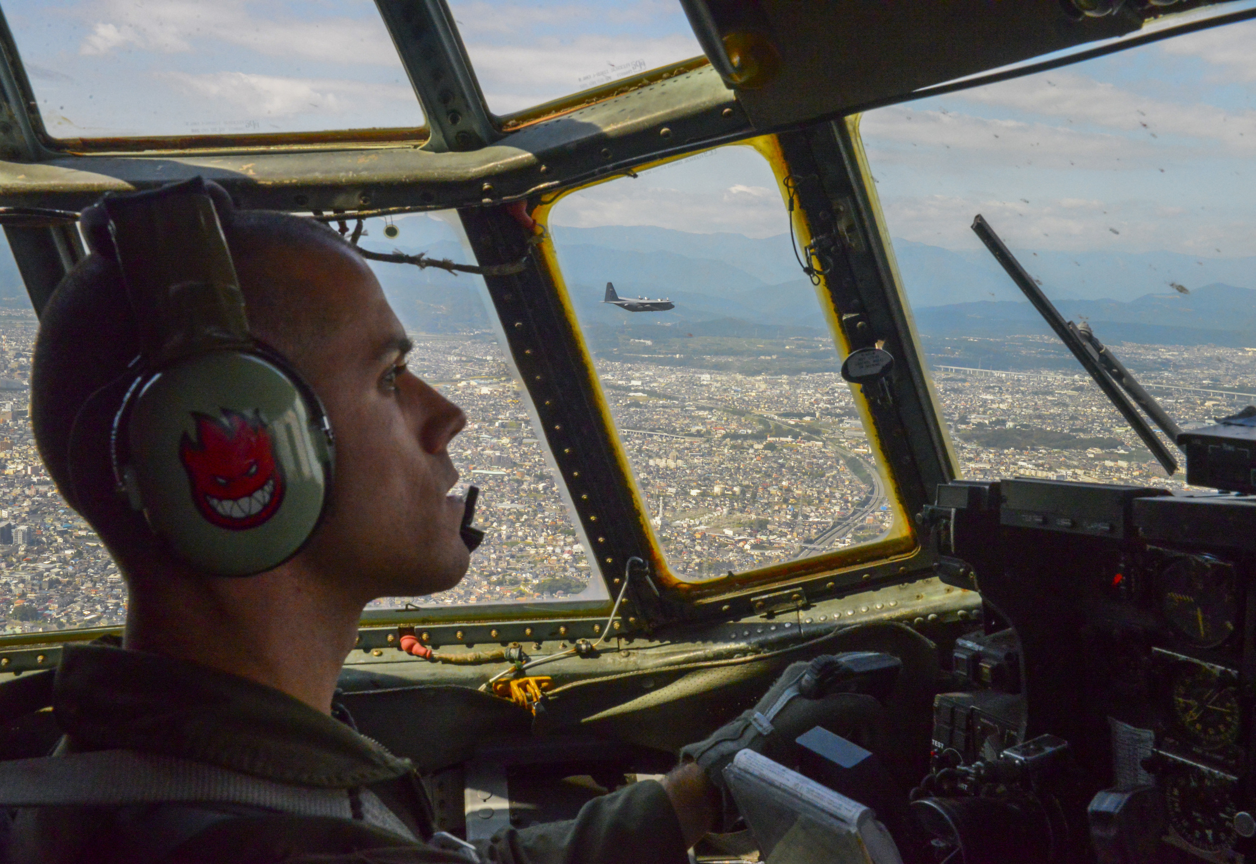 Capt. Matthieu Rigollet, 36th Airlift Squadron C-130 Hercules pilot, flies over Japan, Oct. 14, 2015. The crew flew past Mt. Fuji and performed a practice bundle drop as part of Yokota's ongoing mission to keep all personnel ready to perform real world operations. (U.S. Air Force photo by Airman 1st Class Elizabeth Baker/Released)