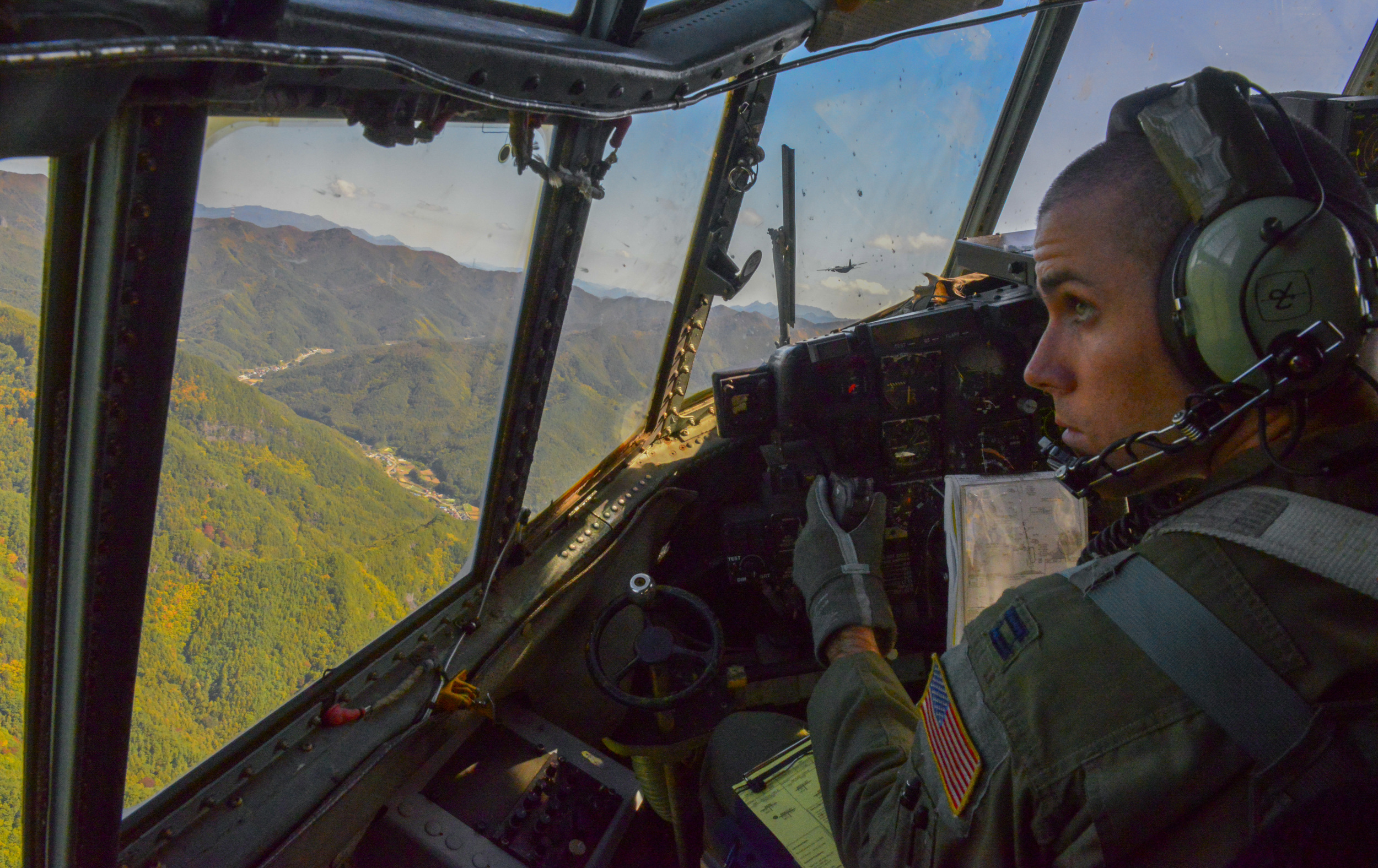 Capt. Matthieu Rigollet, 36th Airlift Squadron C-130 Hercules pilot, flies over the coast of Japan Oct. 14, 2015. The crew flew past Mt. Fuji and performed a practice bundle drop as part of Yokota's ongoing mission to keep all personnel ready to perform real world operations. (U.S. Air Force photo by Airman 1st Class Elizabeth Baker/Released)