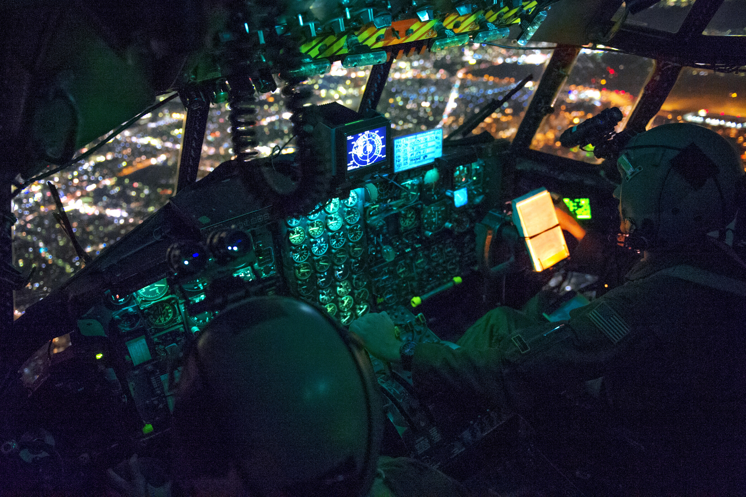 Capt. Stephen Elliot and 1st Lt. Stephen Pineo, 36th Airlift Squadron pilots, prepare to perform an assault landing during a night operations exercise over Yokota Air Base, Japan, Oct. 14, 2015. The training enhanced the pilots' ability to operate in the dark. (U.S. Air Force photo by Airman 1st Class Delano Scott/Released)