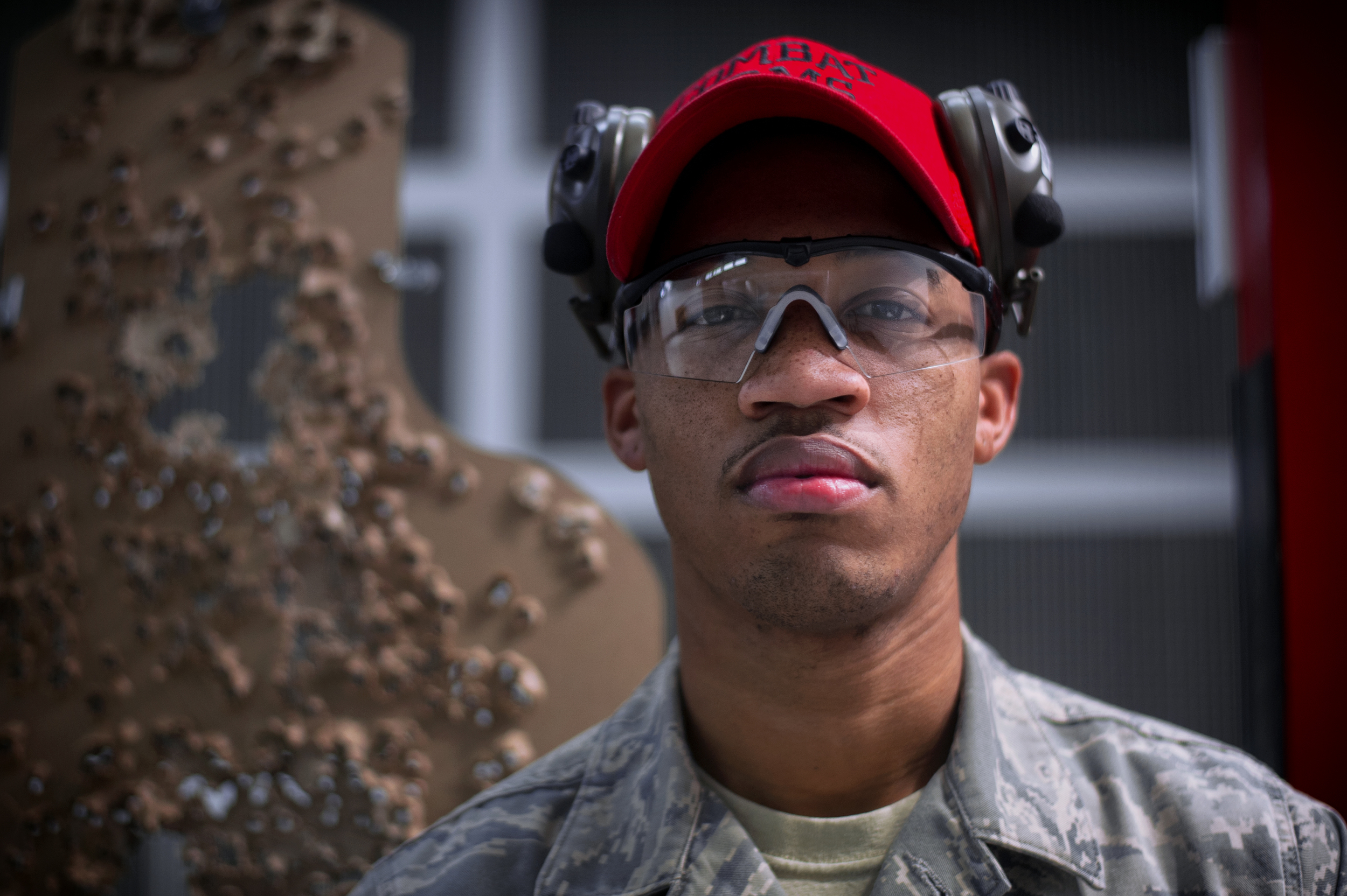 Senior Airman Carlton Dixon, 374th Security Forces Squadron combat arms instructor, poses for a photo at Yokota Air Base, Japan, Oct. 8, 2015. Combat arms training instructors provide ground weapons training and inspections for all Air Force personnel. (U.S. Air Force photo by Airman 1st Class Delano Scott/Released)