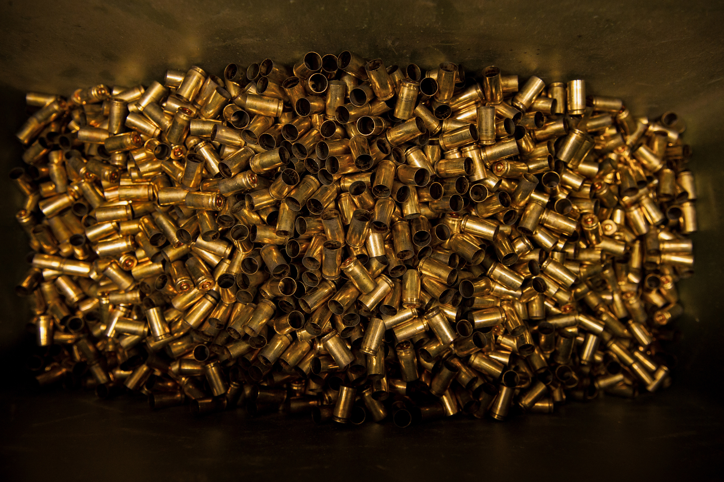 Bullet shells fill a bin at a firing range at Yokota Air Base, Japan, Oct. 8, 2015. Airmen use 5.56 millimeter when performing M-4 carbine qualifying sessions. (U.S. Air Force photo by Airman 1st Class Delano Scott/Released)