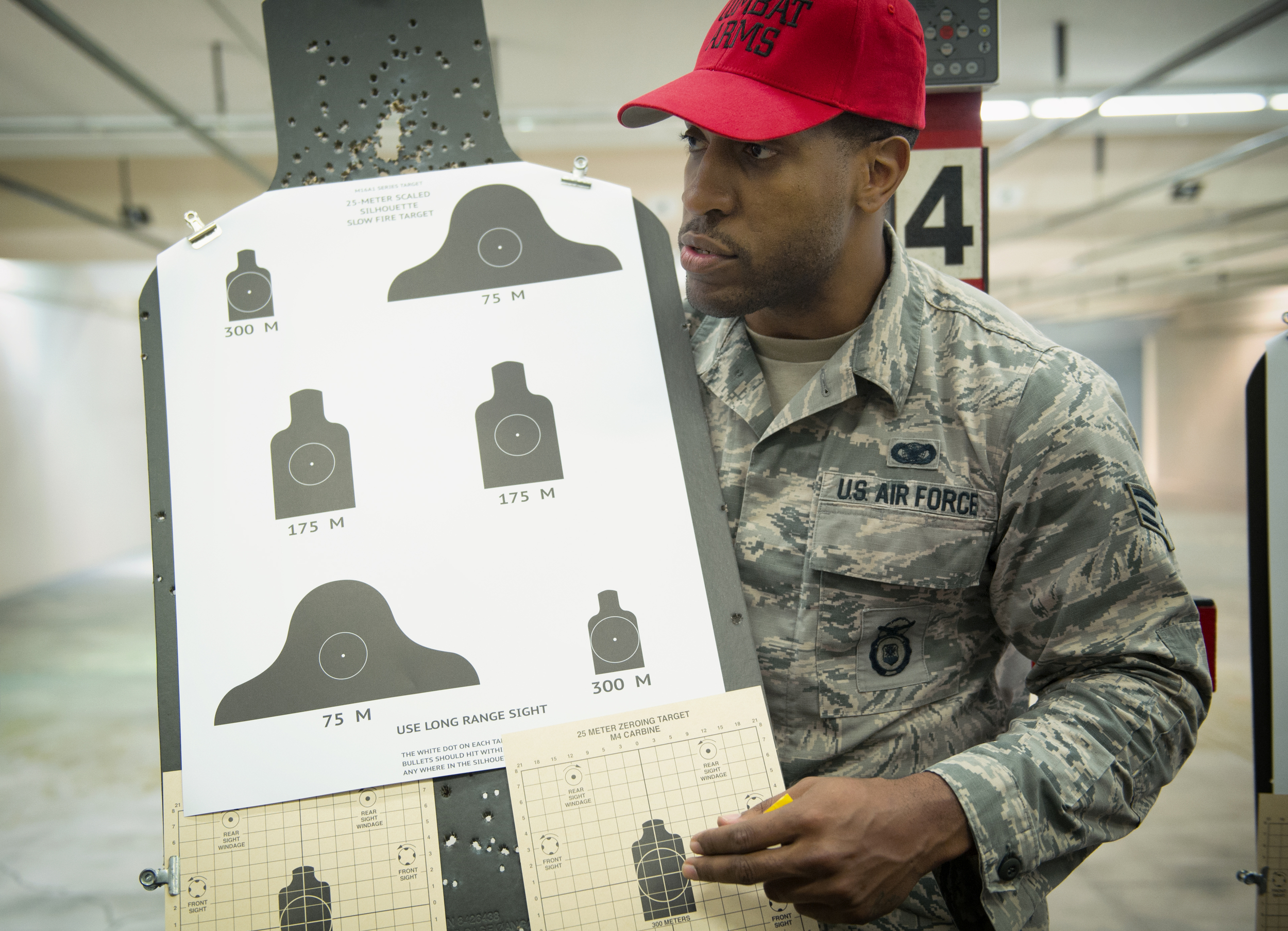 Senior Airman Dominique Adams, 374th Security Forces Squadron combat arms instructor, briefs students on proper weapon aiming and positioning techniques at Yokota Air Base, Japan, Oct. 8, 2015. The combat arms maintenance and training trains between 2,500 - 3,000 students each year. (U.S. Air Force photo by Airman 1st Class Delano Scott/Released)