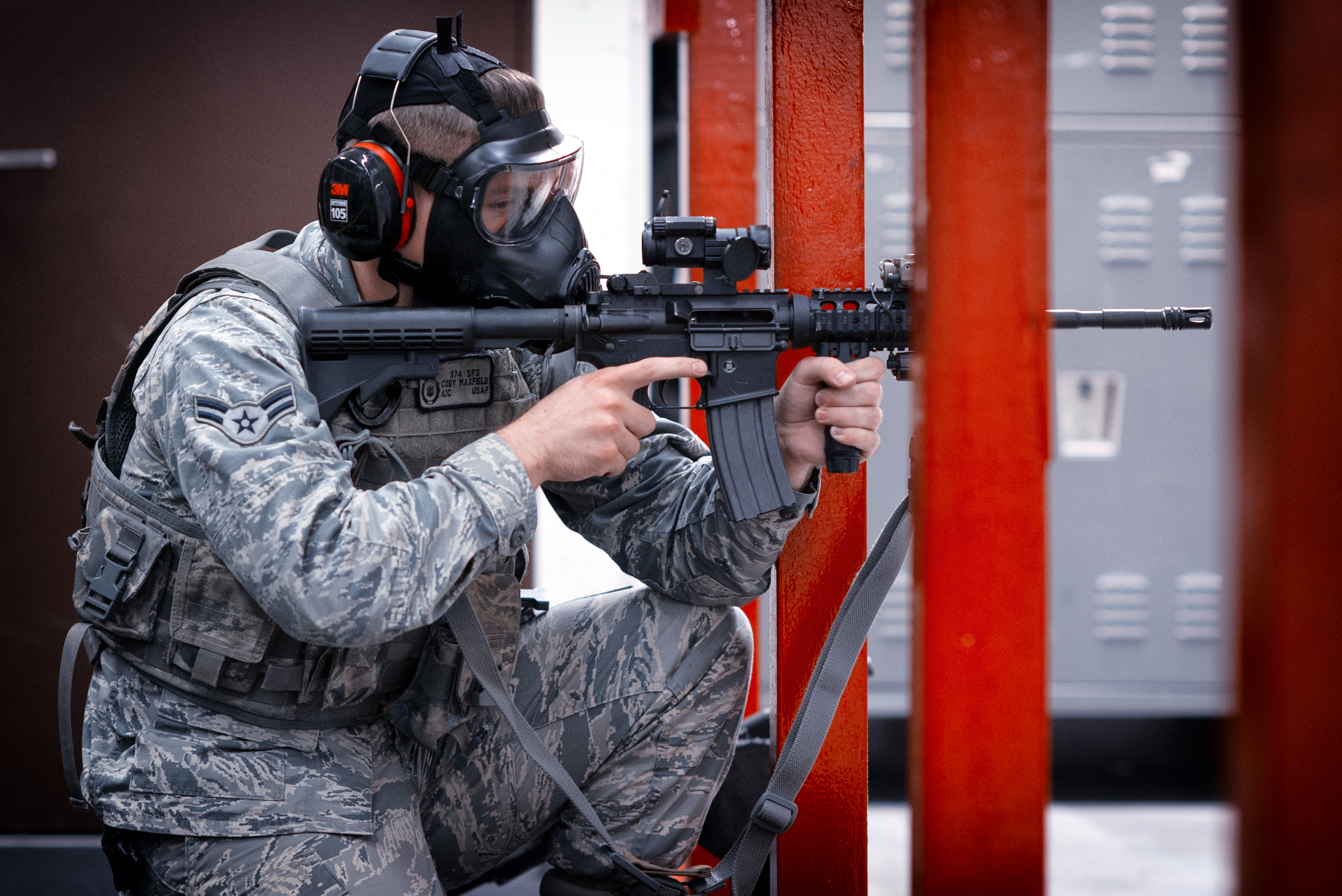 Airman 1st Class Cody Mayfield, 374th Security Forces Squadron patrolman, fires an M-4 Carbine during a Combat Arms Training and Maintenance course at Yokota Air Base, Japan, Oct. 8, 2015. Airmen have to meet minimum qualifications in order to pass the course; they must demonstrate full knowledge of safety rules, procedures and characteristics of multiple weapons and types of ammunition, while also showing target accuracy firing the weapon. (U.S. Air Force photo by Airman 1st Class Delano Scott/Released)