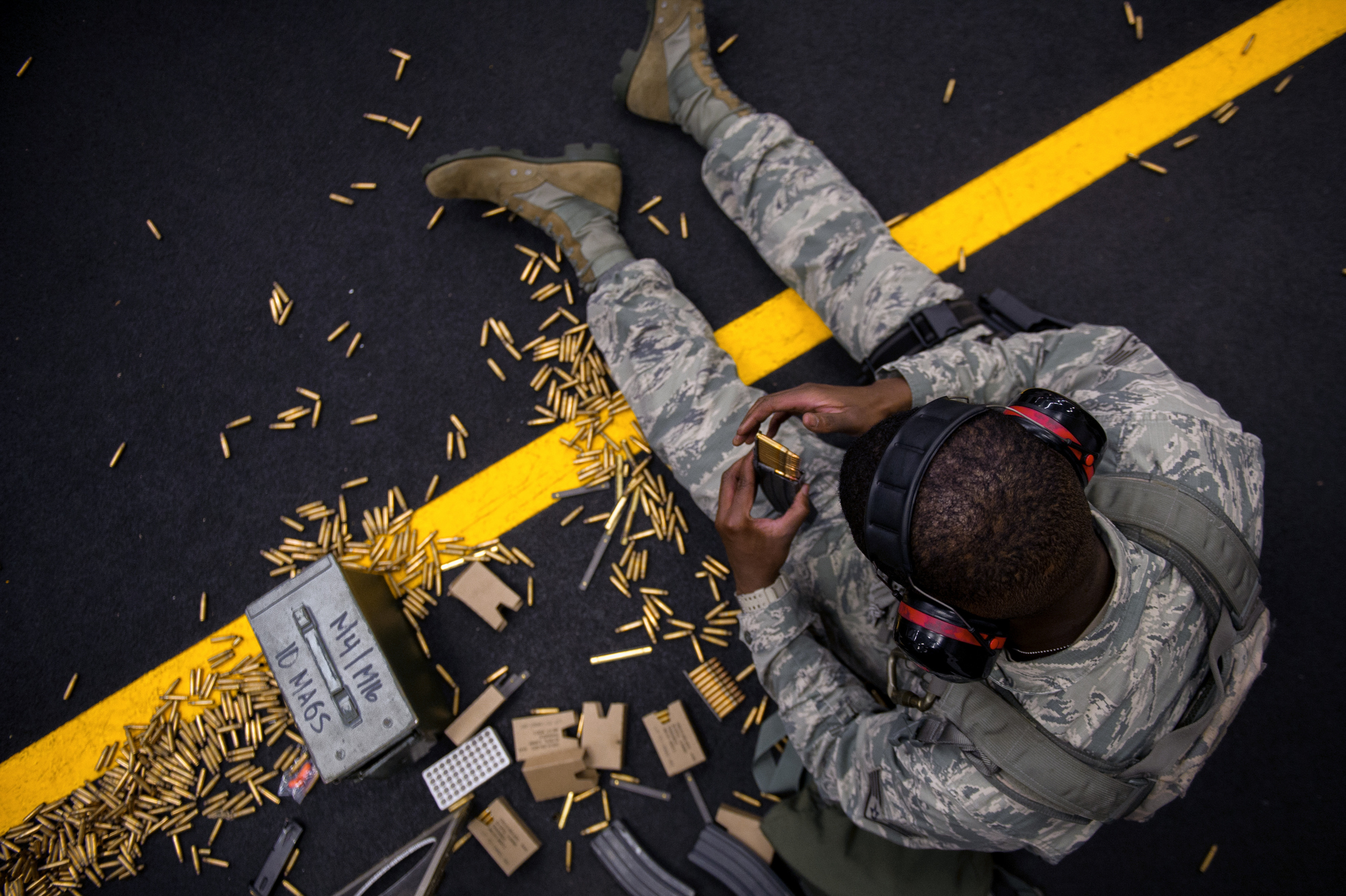 Staff Sgt. Louis Bradshaw, 374th Security Forces Squadron criminal investigator, loads rounds into a magazine at Yokota Air Base, Japan, Oct. 8, 2015. Airmen load the rounds in a magazine to be fired at a target sheet set up at a certain distance down the firing range. (U.S. Air Force photo by Airman 1st Class Delano Scott/Released)
