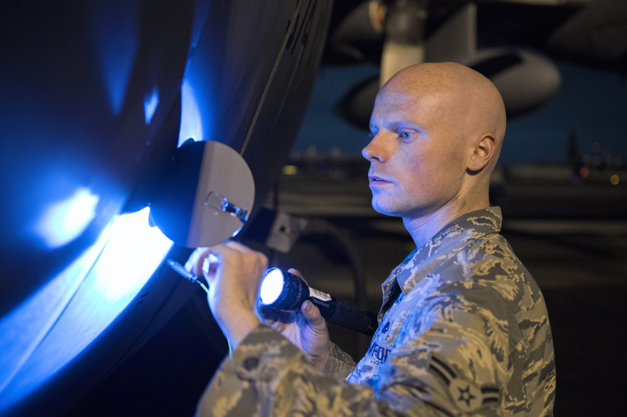 Airman 1st Class Christopher Cook, 374th Aircraft Maintenance Squadron crew chief, inspects a C-130 Hercules for any obvious physical damage or leaks and ensures all fasteners are sealed during VIGILANT ACE 16 at Yokota Air Base, Japan, Nov. 2 2015. Maintainers with the 374 AMXS always work 24 hours a day, 7 days a week, to ensure their C-130 fleet is ready to respond at a moment's notice for any requirement in the Indo-Asia Pacific region. The exercise tested this readiness and Yokota's ability to receive and deploy forces throughout the theater. (U.S. Air Force photo by Staff Sgt. Cody H. Ramirez/Released)