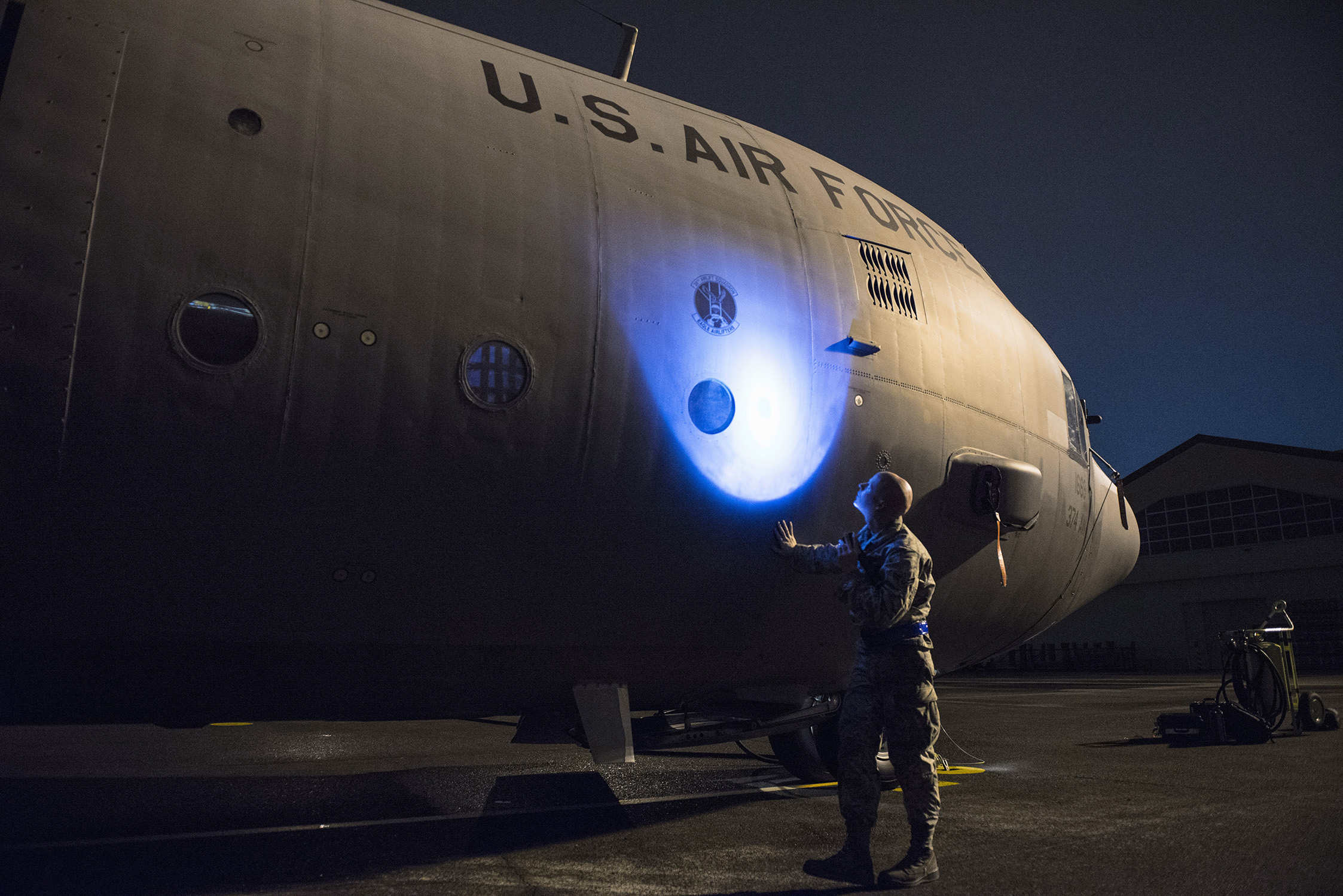 Airman 1st Class Christopher Cook, 374th Aircraft Maintenance Squadron crew chief, inspects a C-130 Hercules for obvious physical damage or leaks and ensures all fasteners are sealed during VIGILANT ACE 16 at Yokota Air Base, Japan, Nov. 2 2015. VIGILANT ACE 16 is a U.S.-Republic of Korea combined exercise aimed at enhancing operational and tactical level coordination through combined and joint combat training. The exercise also provides critical training for the Airmen of the 374th Airlift Wing to maintain peace and stability in Japan and the entire Indo-Asia Pacific region. (U.S. Air Force photo by Staff Sgt. Cody H. Ramirez/Released)