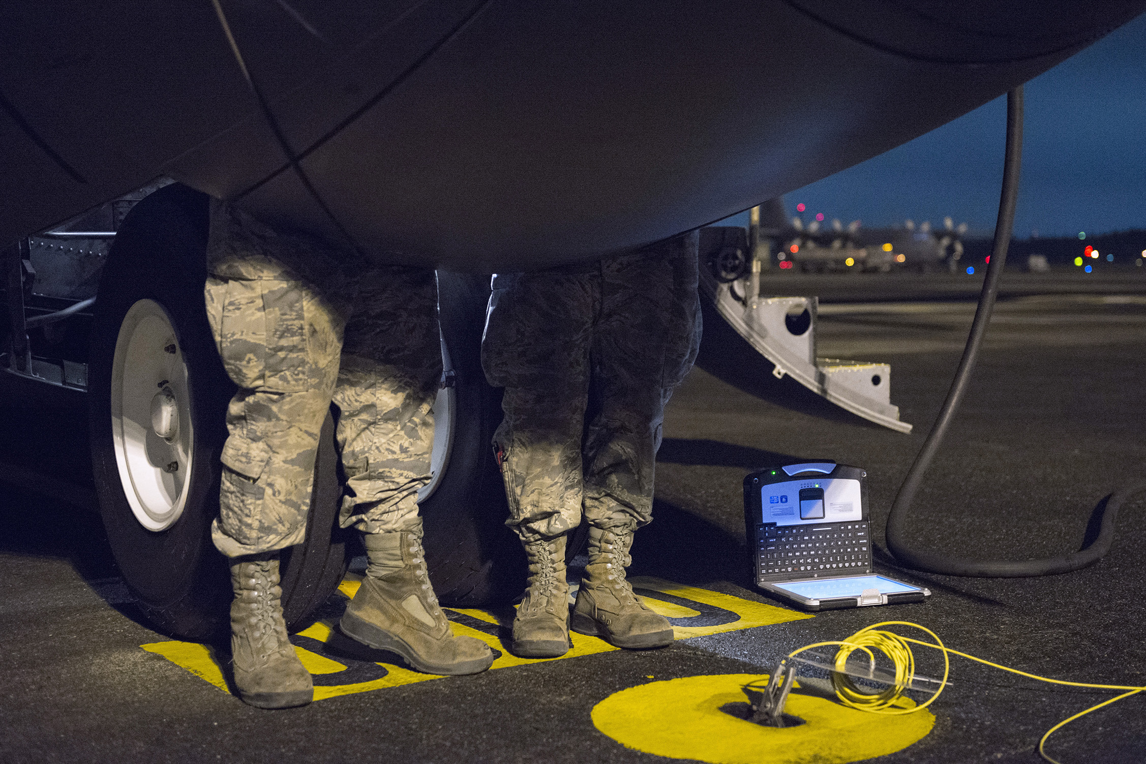 Airmen with the 374 Aircraft Maintenance Squadron inspect landing gear during VIGILANT ACE 16 at Yokota Air Base, Japan, Nov. 2, 2015. The inspection included checking the aircraft for overall working condition and giving it a 72-hour seal for approved flight. These scheduled inspections ensure the aircraft is safe and reliable and allow aircraft to quickly respond to contingencies. Yokota Airmen participating in VIGILANT ACE 16 train alongside aircrews flying different types of aircraft, practicing interoperability that enables aircrew members to be ready for many potential situations. (U.S. Air Force photo by Staff Sgt. Cody H. Ramirez/Released)