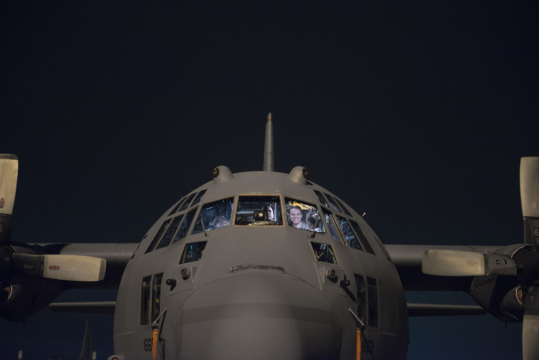Members of the 374th Aircraft Maintenance Squadron test and replace parts of a C-130 Hercules cockpit during VIGILANT ACE 16 at Yokota Air Base, Japan, Nov. 2, 2015. Maintainers with the 374 AMXS work 24 hours a day, 7 days a week, to ensure their C-130 fleet is ready to respond at a moment's notice for any requirement in the Indo-Asia Pacific region. The exercise tested this readiness and Yokota's ability to receive and deploy forces throughout the theater. (U.S. Air Force photo by Staff Sgt. Cody H. Ramirez/Released)