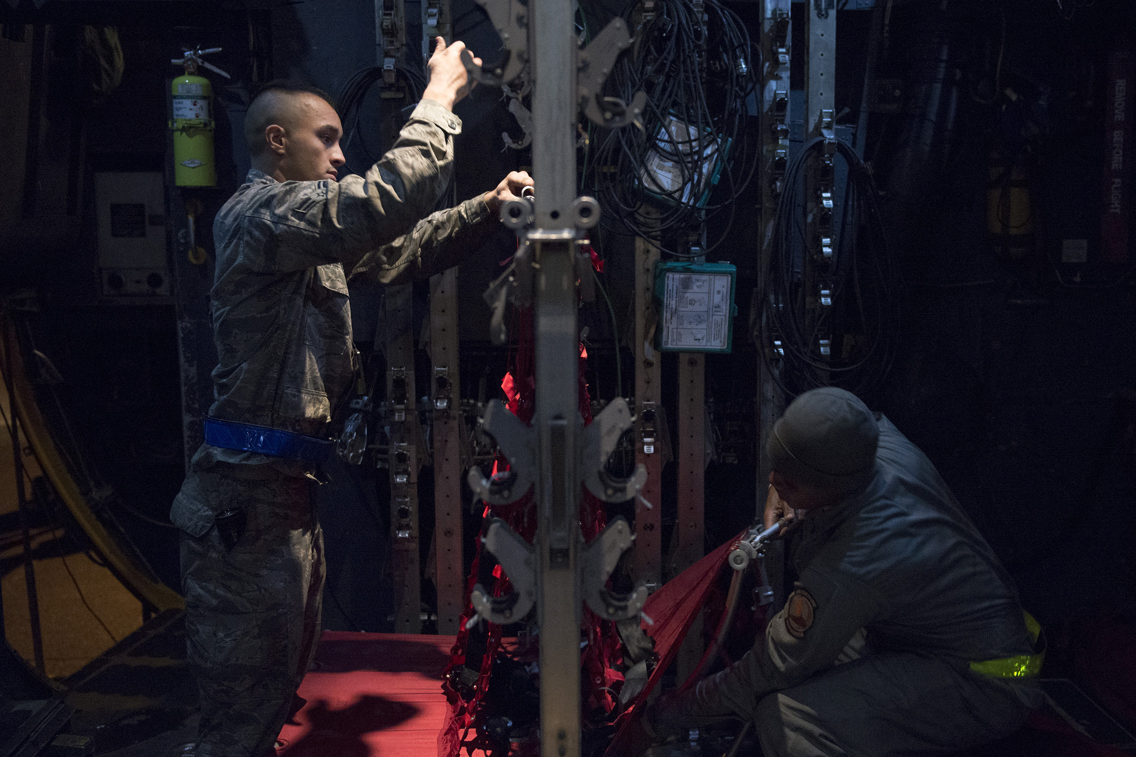 Airmen prepare seating in a C-130 Hercules during VIGILANT ACE 16 at Yokota Air Base, Japan, Nov. 2, 2015. Multiple C-130s were inspected, reconfigured and fueled in preparation of flights for VIGILANT ACE 16, a U.S.-Republic of Korea combined exercise aimed at enhancing operational and tactical level coordination through combined and joint combat training. The exercise also provides critical training for the Airmen of the 374th Airlift Wing to maintain peace and stability in Japan and the entire Indo-Asia Pacific region. (U.S. Air Force photo by Staff Sgt. Cody H. Ramirez/Released)