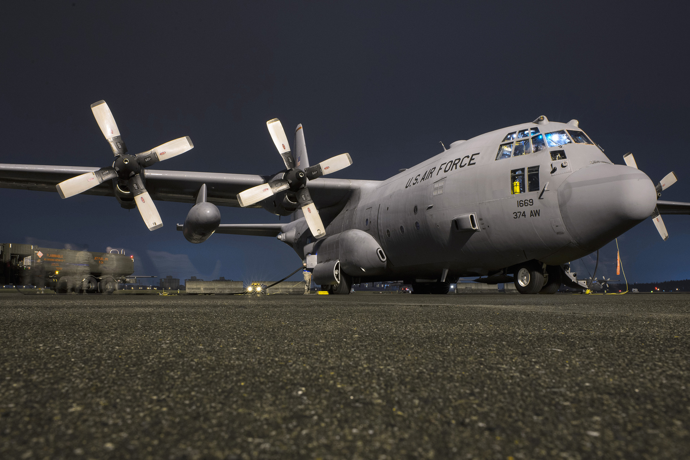Airmen with the 374th Aircraft Maintenance Squadron and 374th Logistical Readiness Squadron fuel a C-130 Hercules during VIGILANT ACE 16 at Yokota Air Base, Japan, Nov. 2, 2015. Airmen prepped multiple C-130s to take part in operational flights during VIGILANT ACE 16, a U.S.-Republic of Korea combined exercise aimed at enhancing operational and tactical level coordination through combined and joint combat training. The exercise also provides critical training for the Airmen of the 374th Airlift Wing to maintain peace and stability in Japan and the entire Indo-Asia Pacific region. (U.S. Air Force photo by Staff Sgt. Cody H. Ramirez/Released)