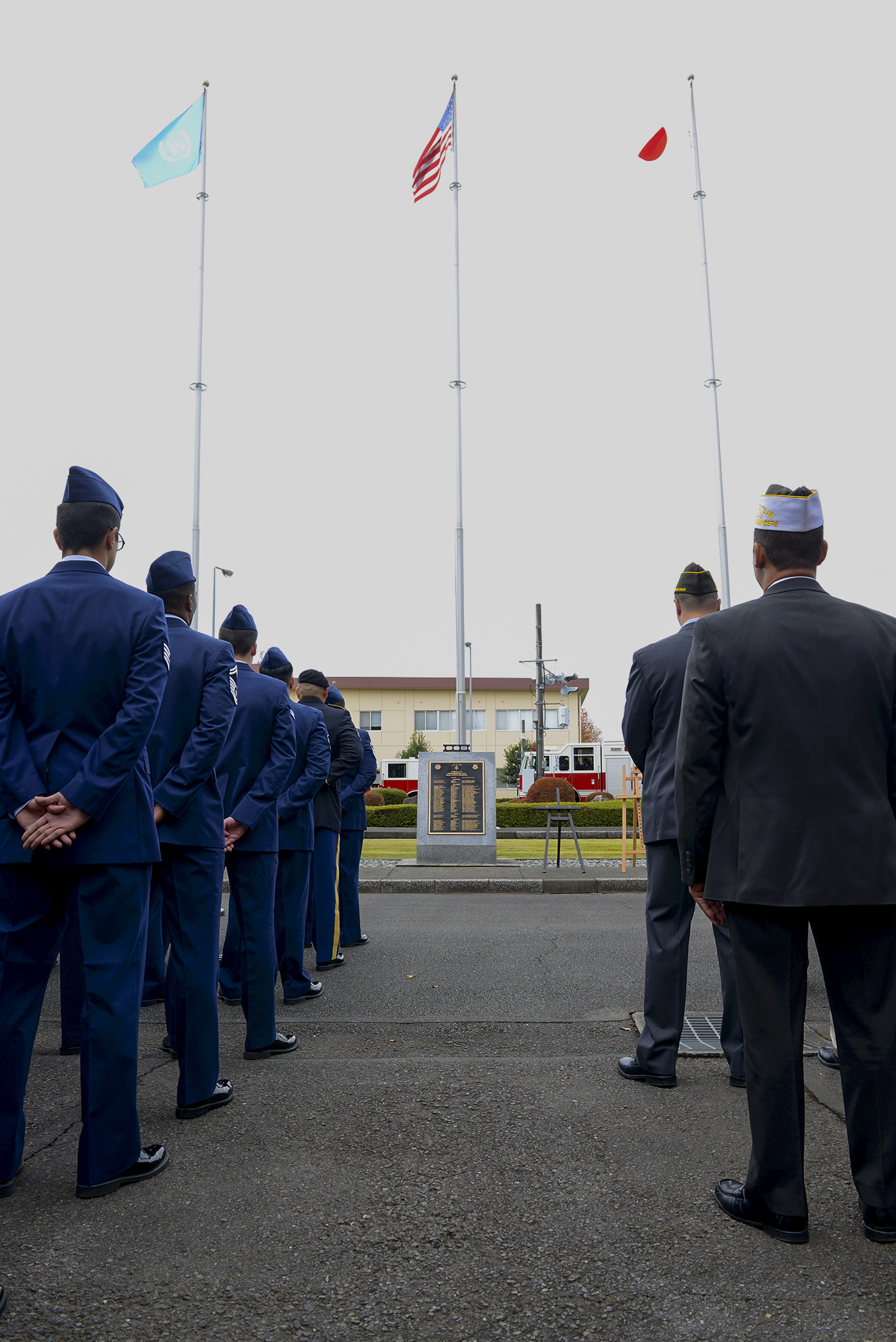 Service members stand in formation during a Veterans Day ceremony at Yokota Air Base, Japan, Nov. 11, 2015. Veterans Day celebrates the service of all U.S. military veterans and coincides with Armistice Day and Remembrance Day which are celebrated in other countries, marking the anniversary of the end of World War I. (U.S. Air Force photo by Senior Airman David C. Danford/Released)