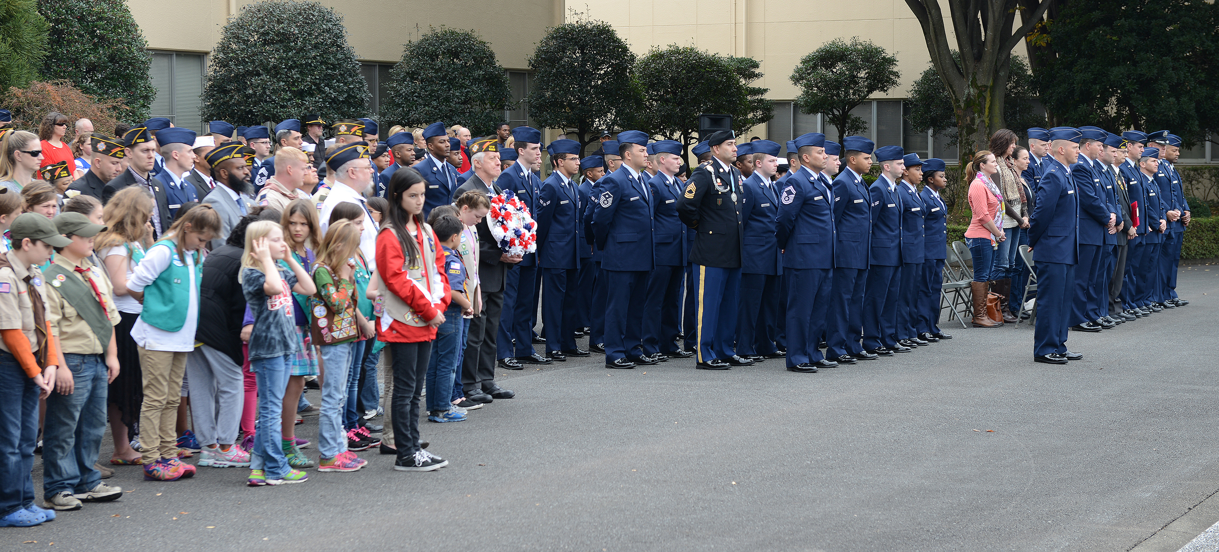 Members of Team Yokota attend a Veterans Day ceremony at Yokota Air Base, Japan, Nov. 11, 2015. Veterans Day celebrates the service of all U.S. military veterans and coincides with Armistice Day and Remembrance Day which are celebrated in other countries, marking the anniversary of the end of World War I. (U.S. Air Force photo by Senior Airman David C. Danford/Released)