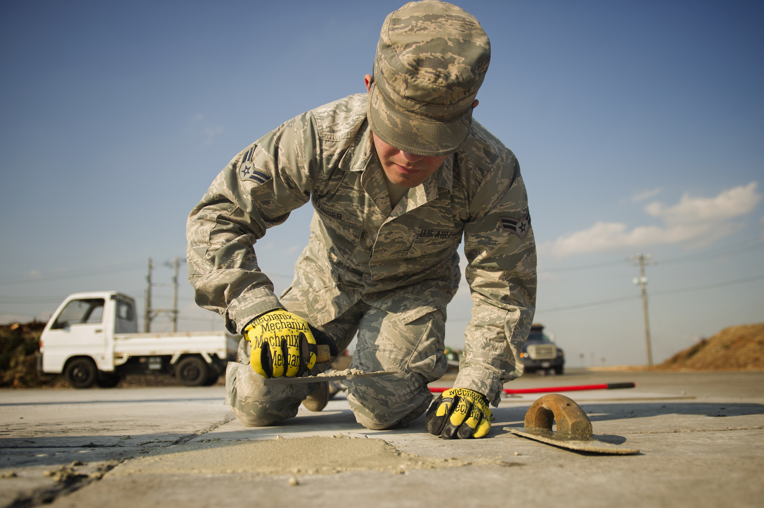 Airman 1st Class Brendan Kinser, 374th Civil Engineer Squadron pavements and equipment apprentice, performs a spall repair on a section of Yokota Air Base, Japan, Jan. 13, 2016. Aptly named 'Dirt Boys', 374 CES pavement and equipment Airmen perform spall repairs as part of their preventative maintenance practices to ensure Yoktoa's airfield is free of cracks and tears. (U.S. Air Force photo by Airman 1st Class Delano Scott/Released)