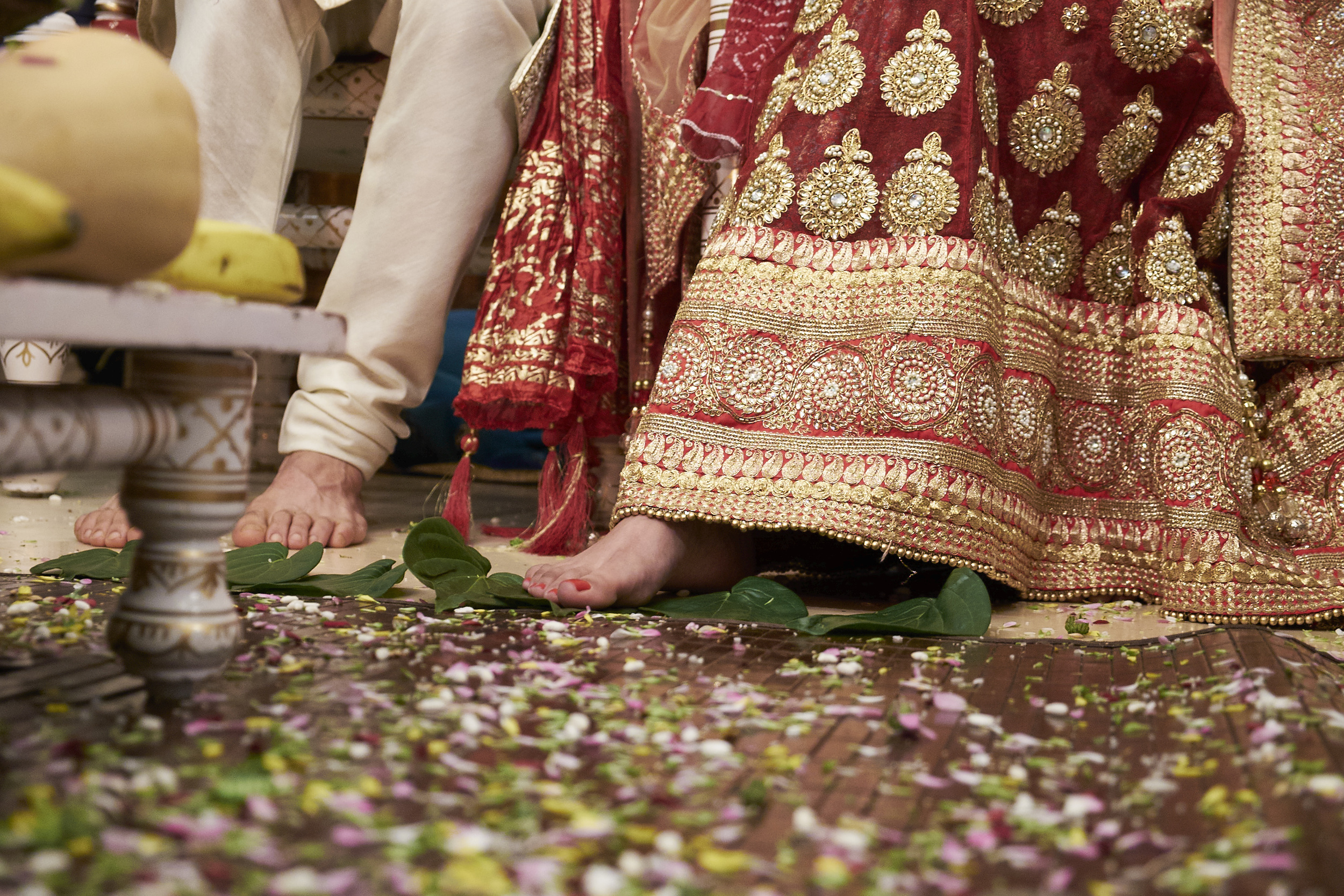 Seven Steps are taken to reiterate the couple's aspirations for their married life. This is represented by the Bride placing her toe on seven leaves, one by one as the Brahmin talks us through these steps.