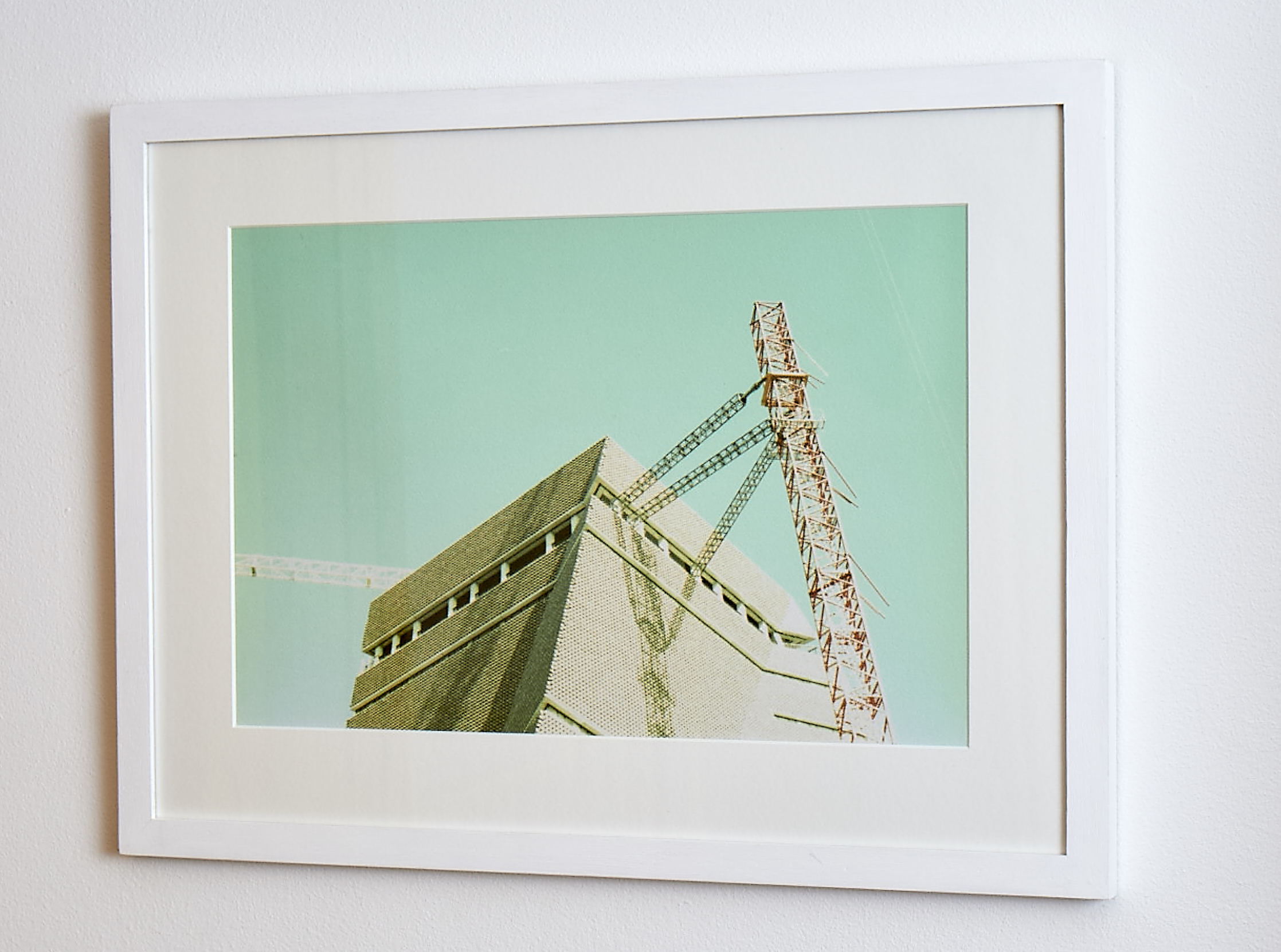 """Tate Addition   The simplicity of the white frame sets off the unique hues of this cross-processed print. Shot whilst the new wing of the Tate Modern was being erected, it is unlikely to ever be reenacted!   Cross-processed image on Textured paper.    Frame Size approx. 22x 16.5""""    COST £69.00"""