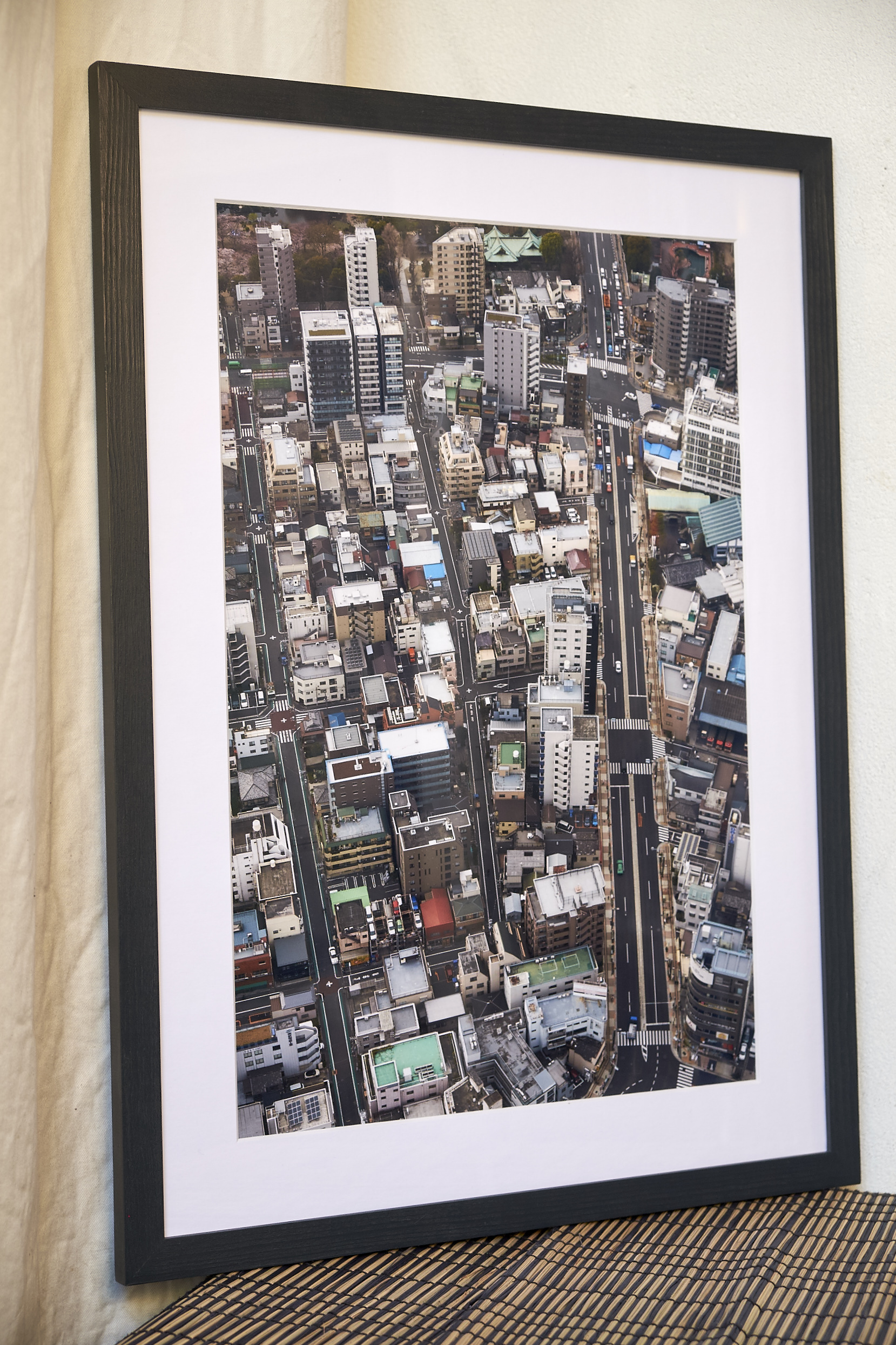"""Seeing Green   Taken from 300 metres high in Tokyo's Sky Tower, allowing unique views over the city. This is part of a series of six images which was recently exhibited with London Independent Photography.   Frame Size approx. 23 x 17"""", painted in a dark, oily blue.    COST £75.00"""