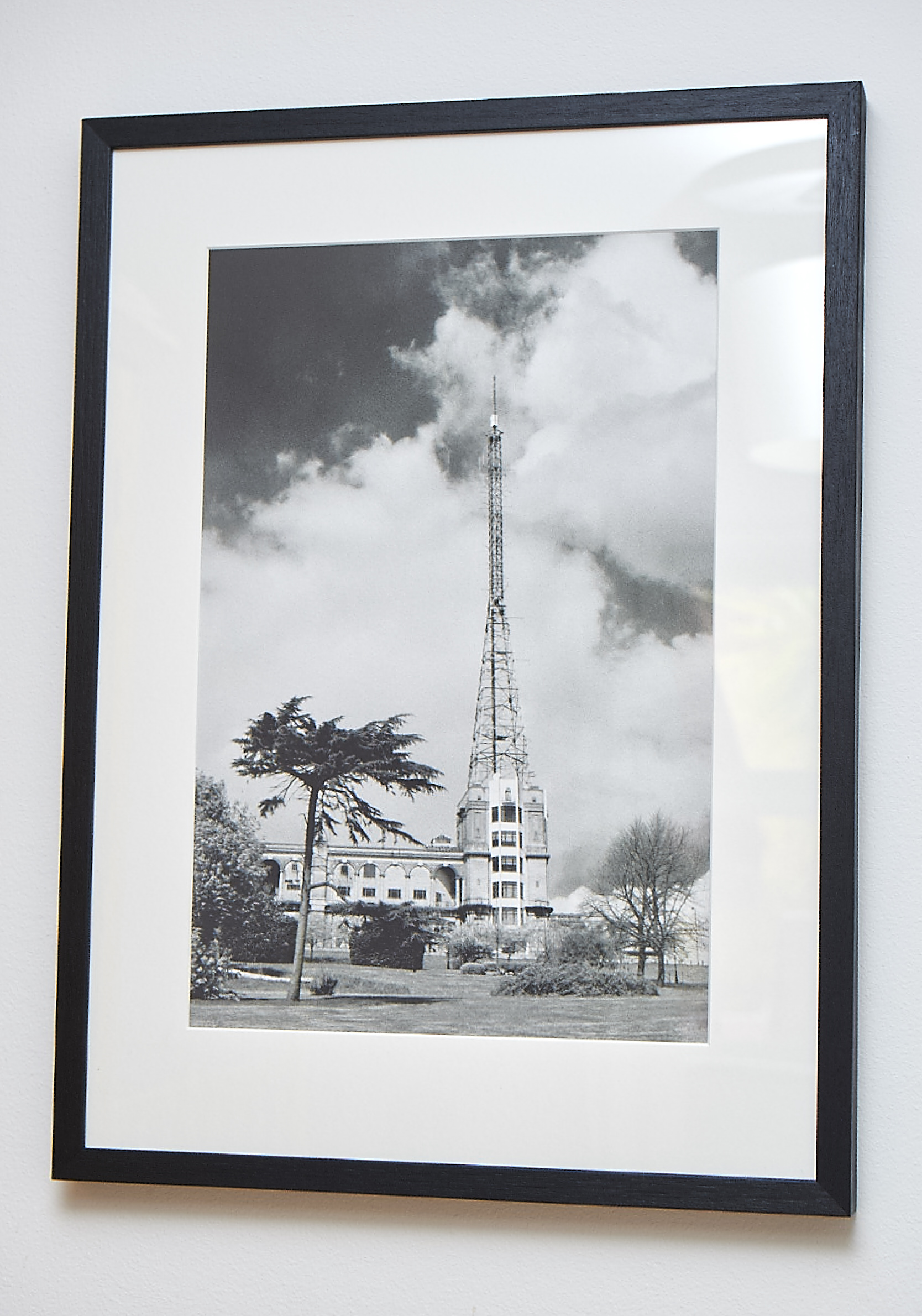 """High Frequency *SOLD*   An unusual view of Alexandra Palace, shot on black & white infrared film. This gives a softer feel to the image and creates more drama in the sky. I did sell a copy in the last sale, but subsequently needed to print another copy for an exhibition, so here it is again!   Printed on Hahnemuhle German Etching Paper.    Frame Size approx 25 x 18.5""""    COST £75.00 *SOLD*"""