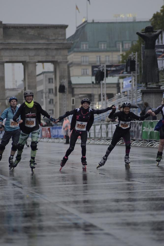Berlin-marathon-inline-skating-2017-finish-line-holding-hands-The-Wong-Janice2.jpg