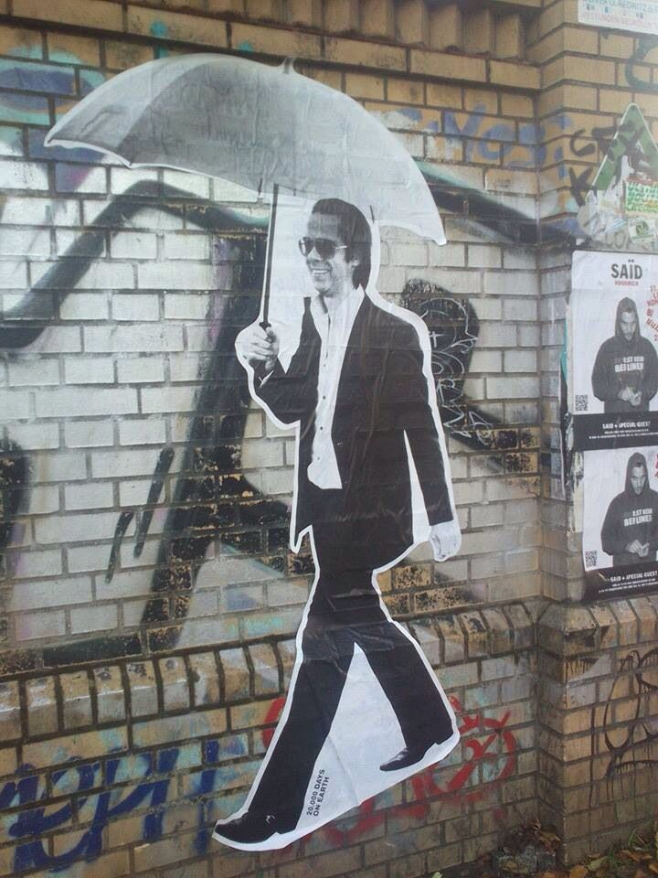 Paste-up of Nick Cave - smiling!