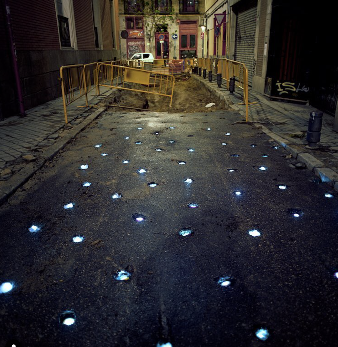image: 'Luminous Craters' by Luzinterruptus (@luzinterruptus), Madrid, 2009