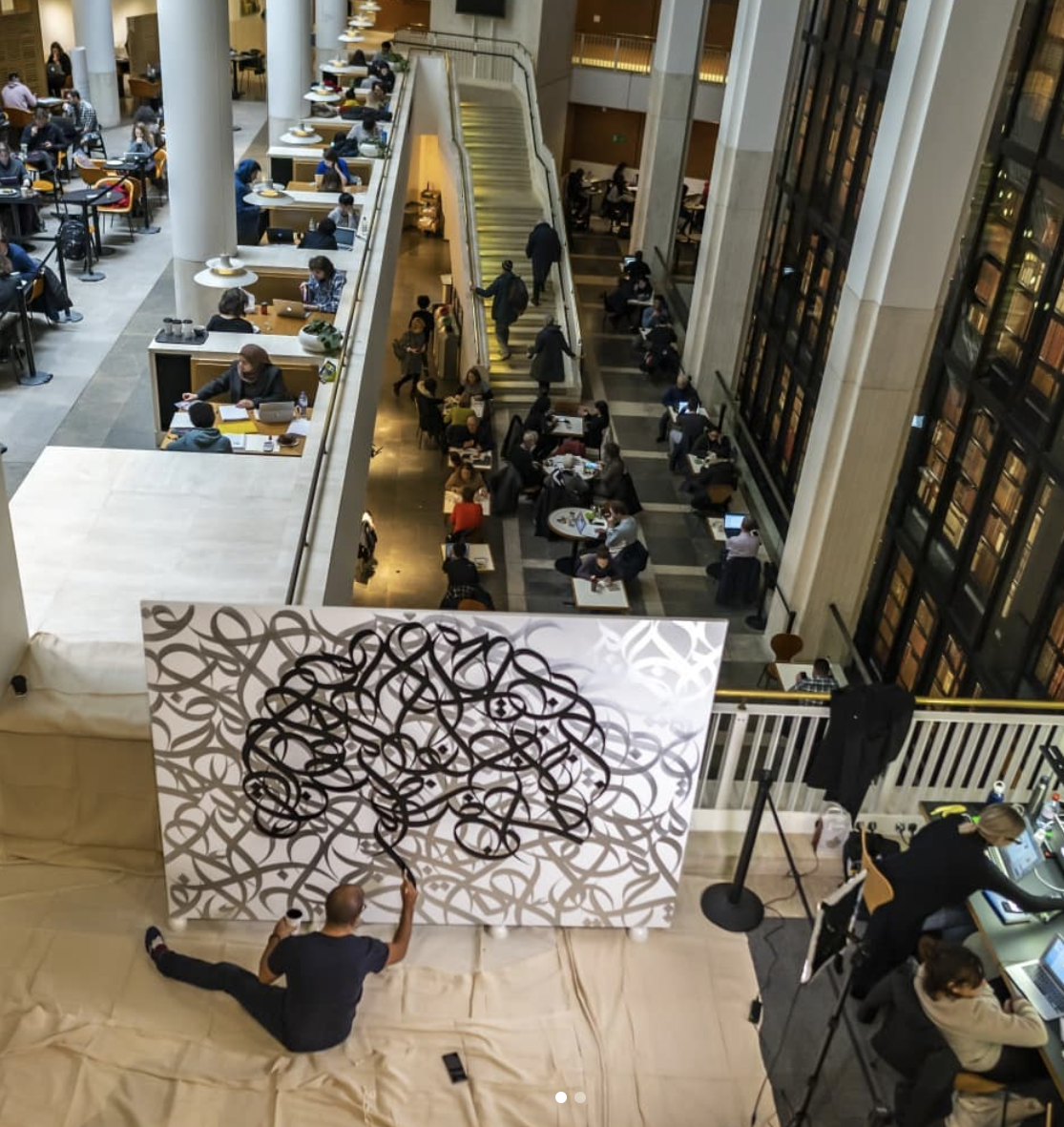 eL Seed painting at the British Library for the exhibition, 'Writing: Making Your Mark' 2019